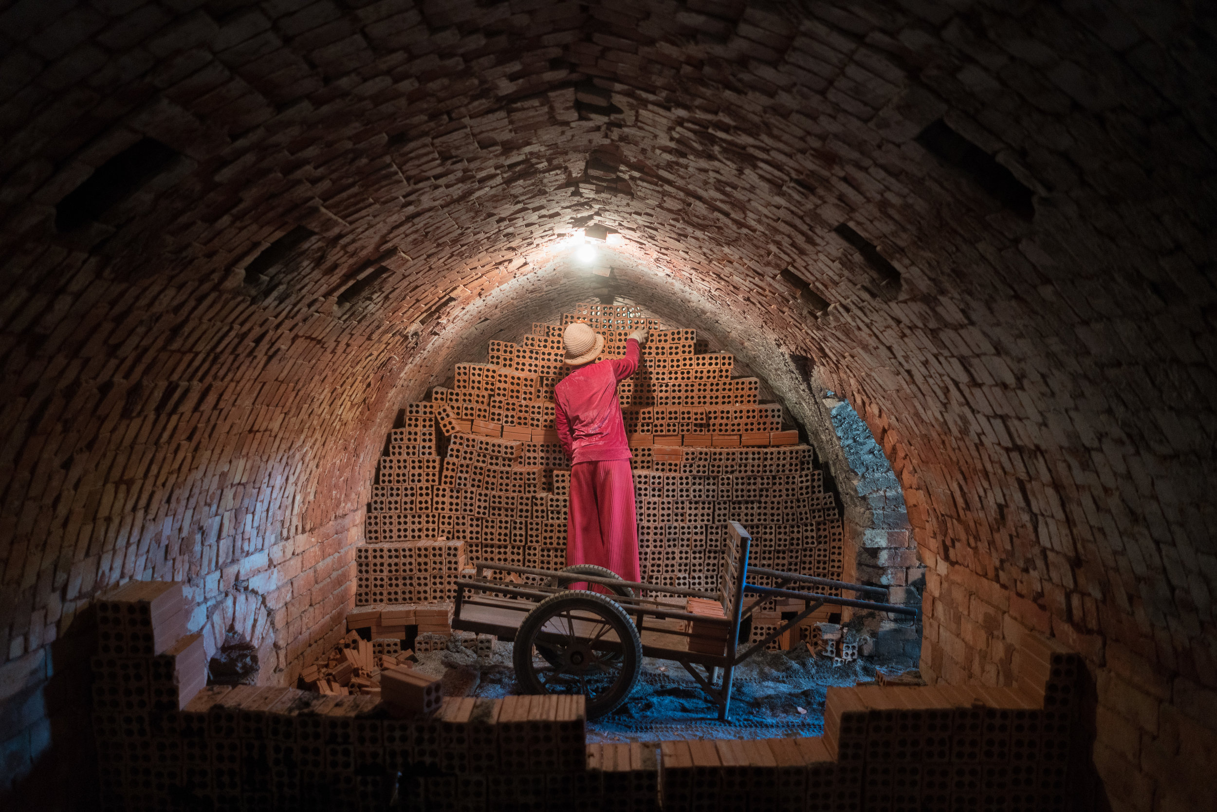 Stacking of a brick-kiln in Cambodia by  Thomas Cristofoletti  for the Blood Bricks project