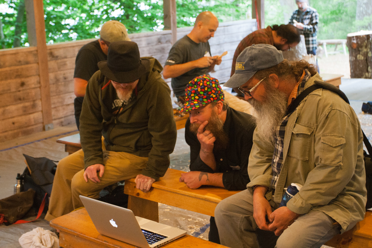 Don, Jarrod, and Peter looking at some spoon carving video that Jo-Jo shot while on vacation.