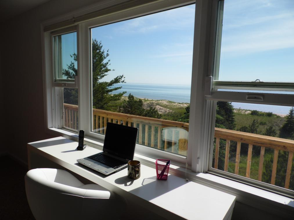 Work in bliss as you gaze at the dunes, beach, and water -
