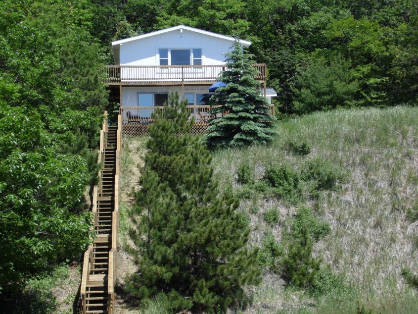 The cottage atop a dune makes for stunning views each and every day -