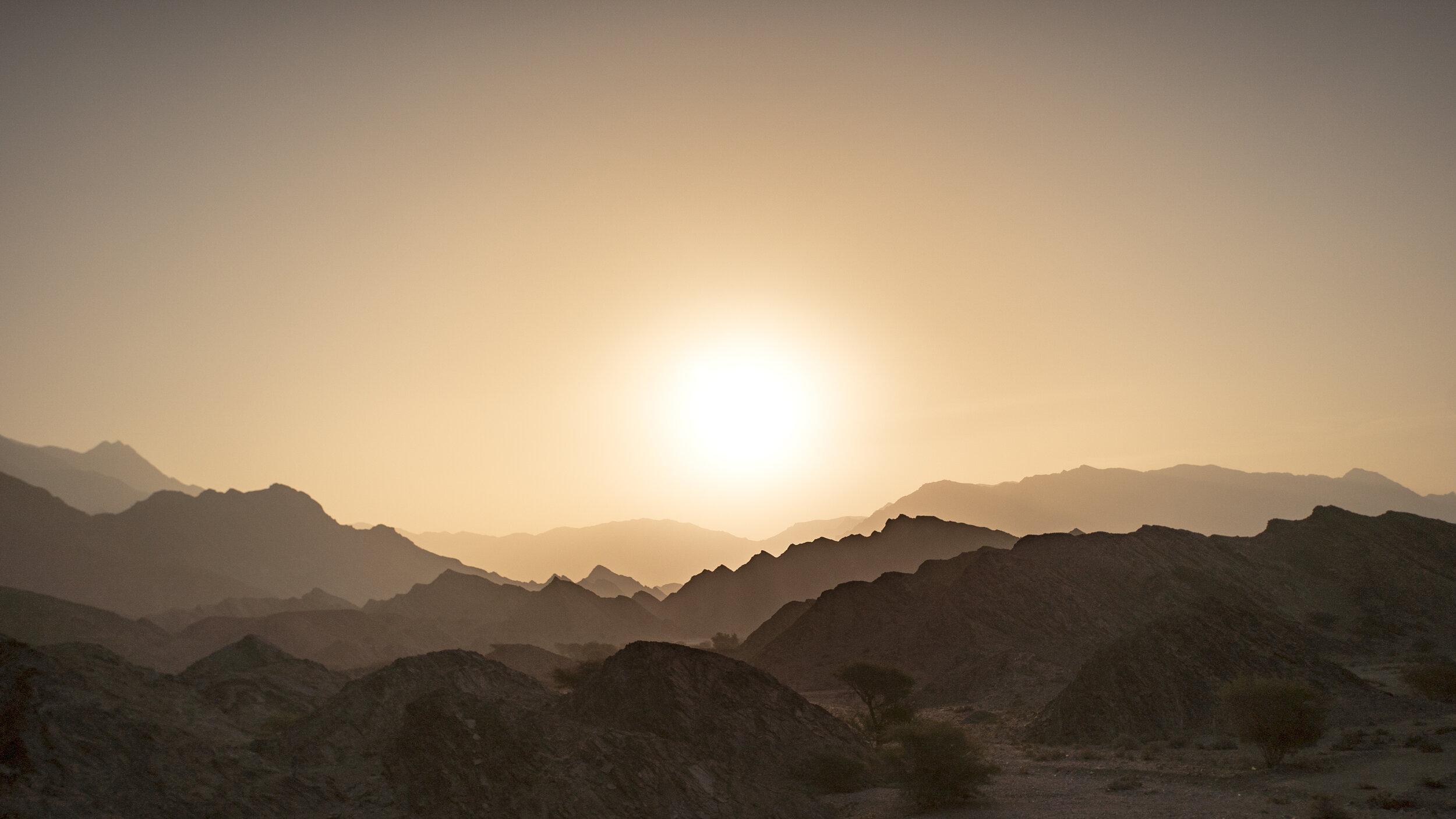 sun rise many peaks.jpg