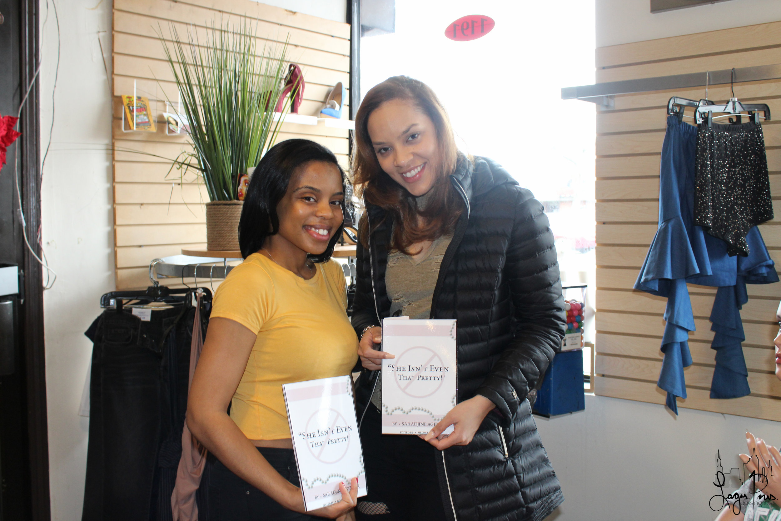 Event attendees proudly pose with their newly purchased copies of   She Isn't Even That Pretty  .