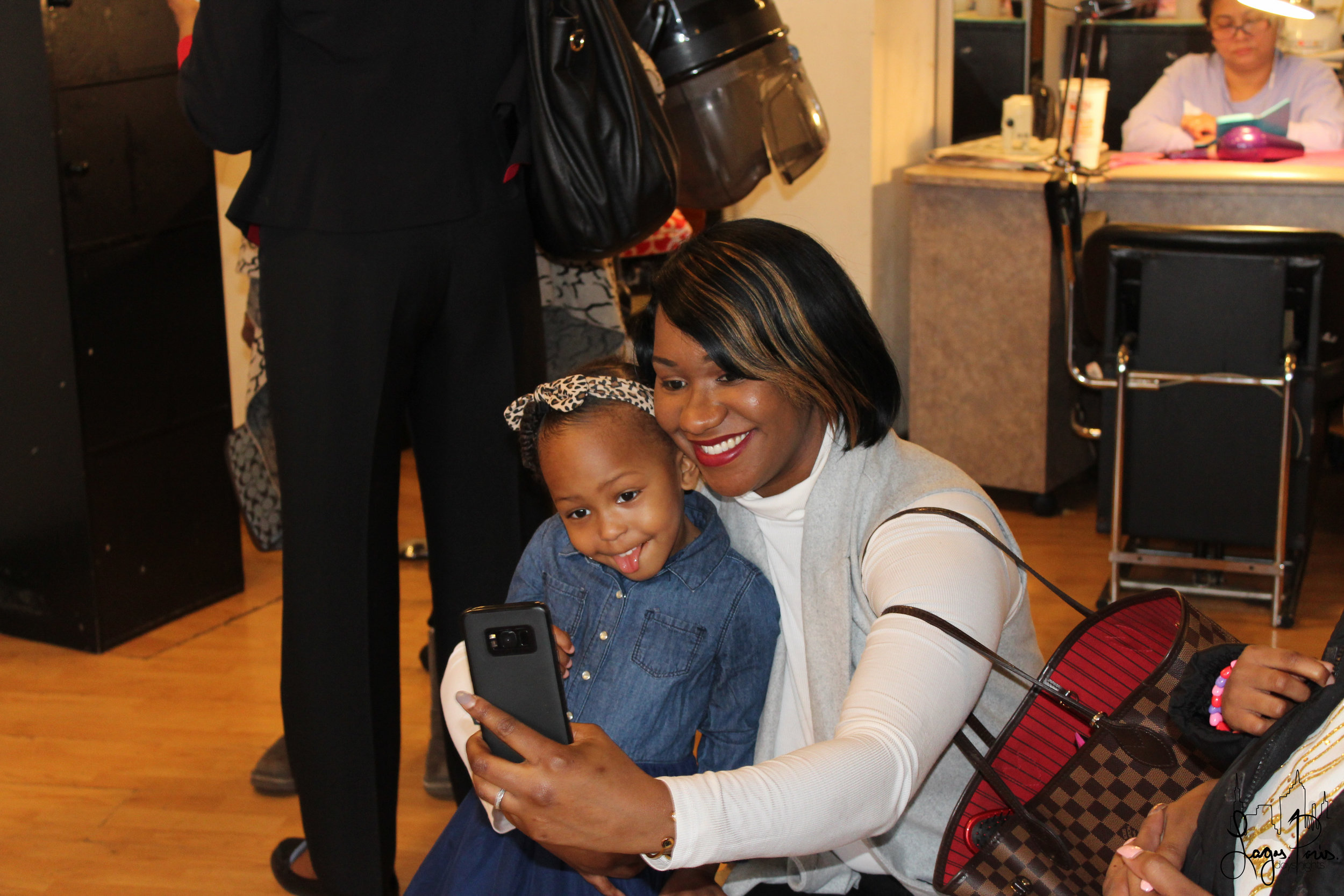 A mother and daughter, embody the spirit of the event with a fun selfie!