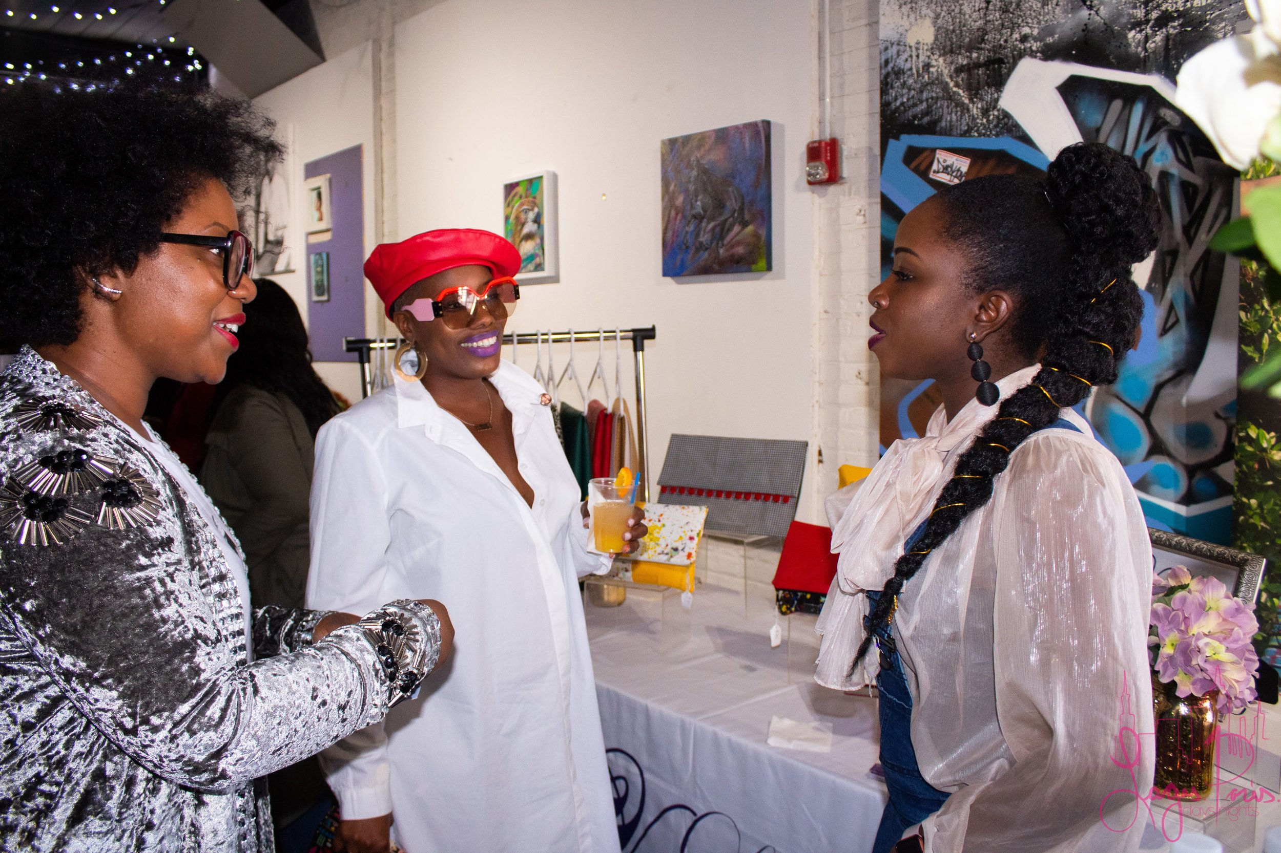 The fly ladies if Miami based styling company, Pardon Our Style (left)chatting it up with Stephanie Voltaire of V-Lure Designs.