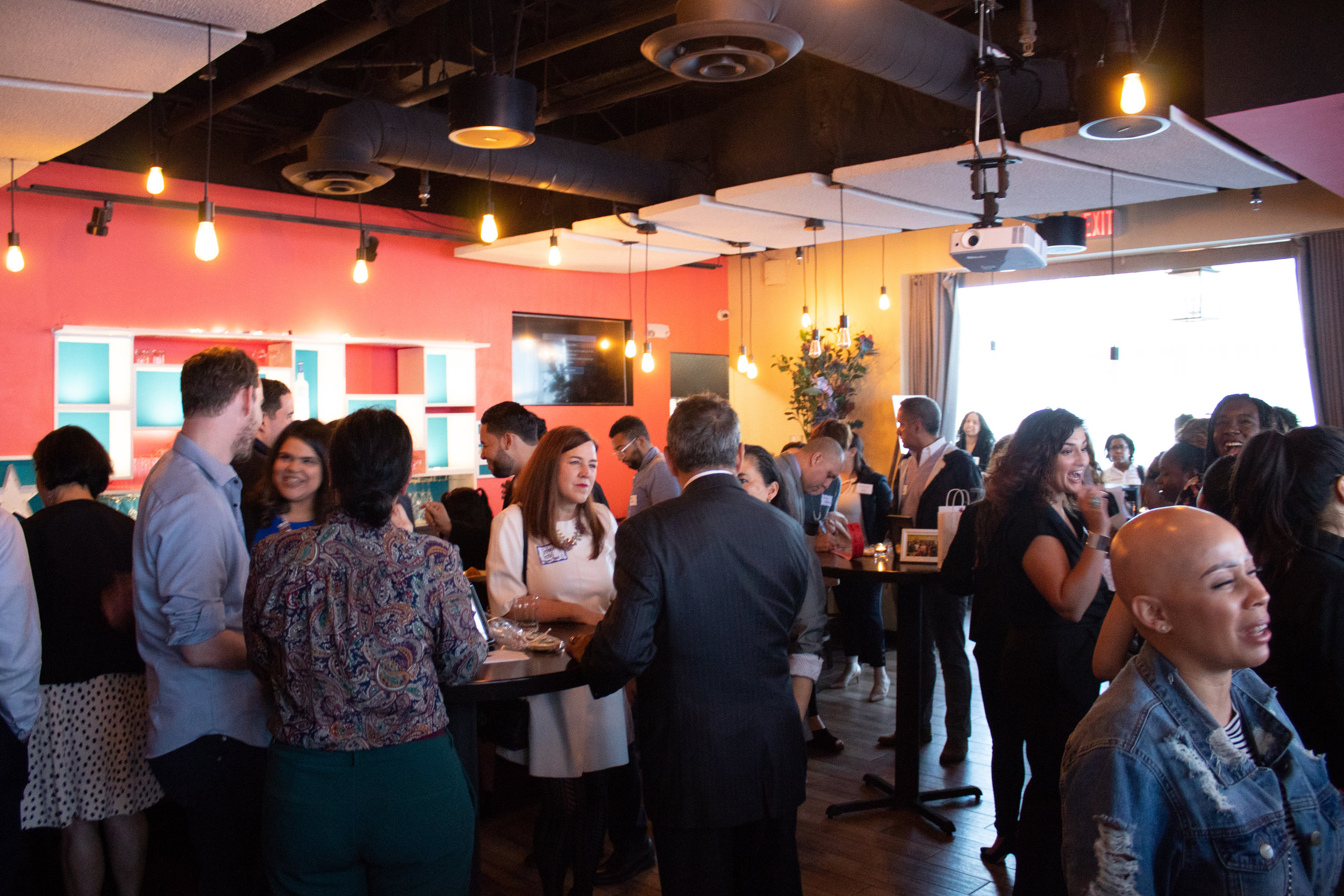 Attendees mingle, have drinks and socialize during The Power of One Fundraiser.