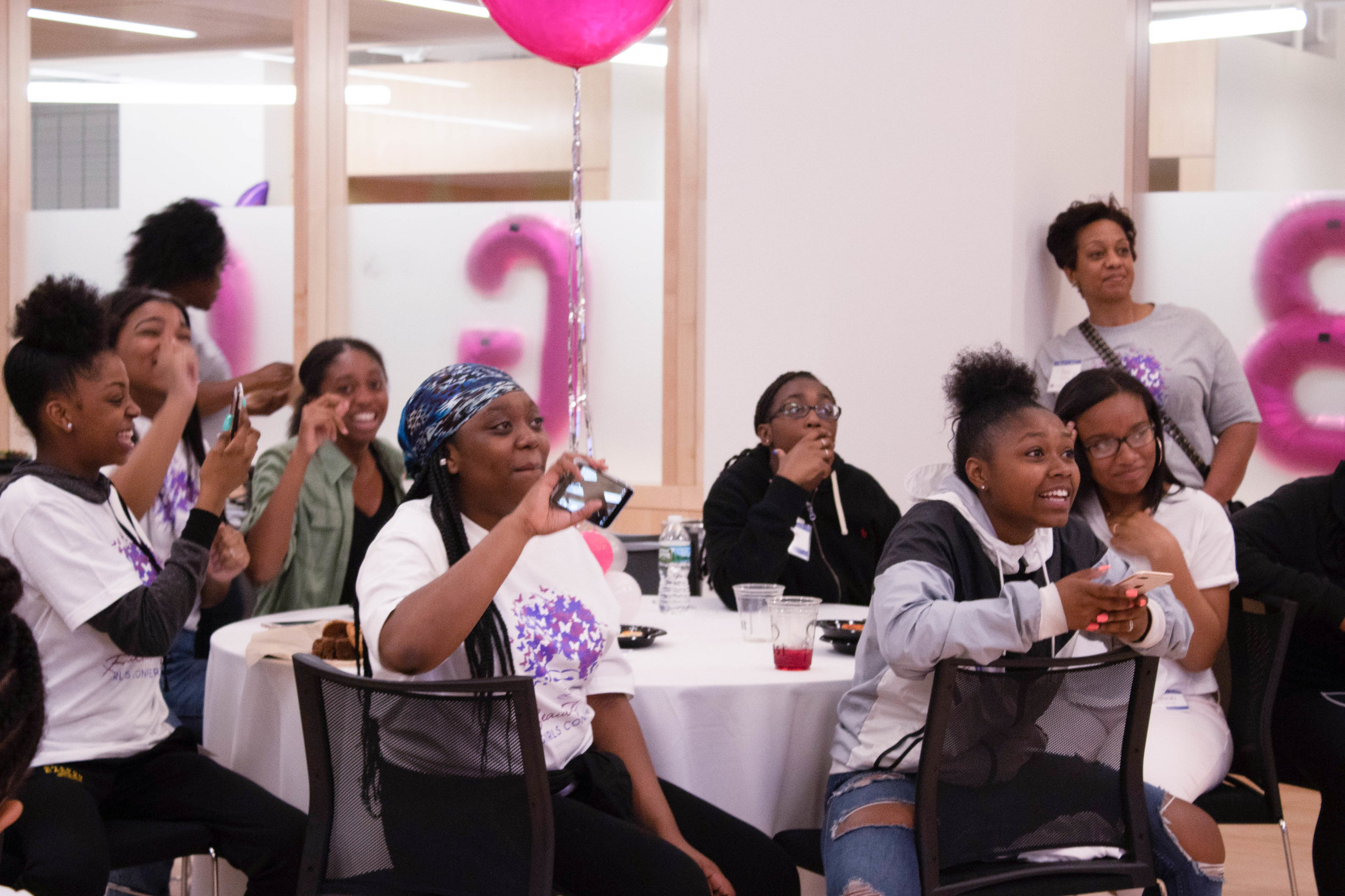 Cheering & looks of amazement as the ladies cheered on their fellow peer, rapper J-Simone.