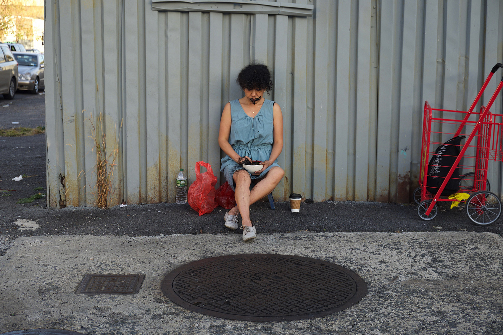 Monica Palma, Chacmool3, Burnt tortillas, coffee, saliva, dress and manhole cover, 2017