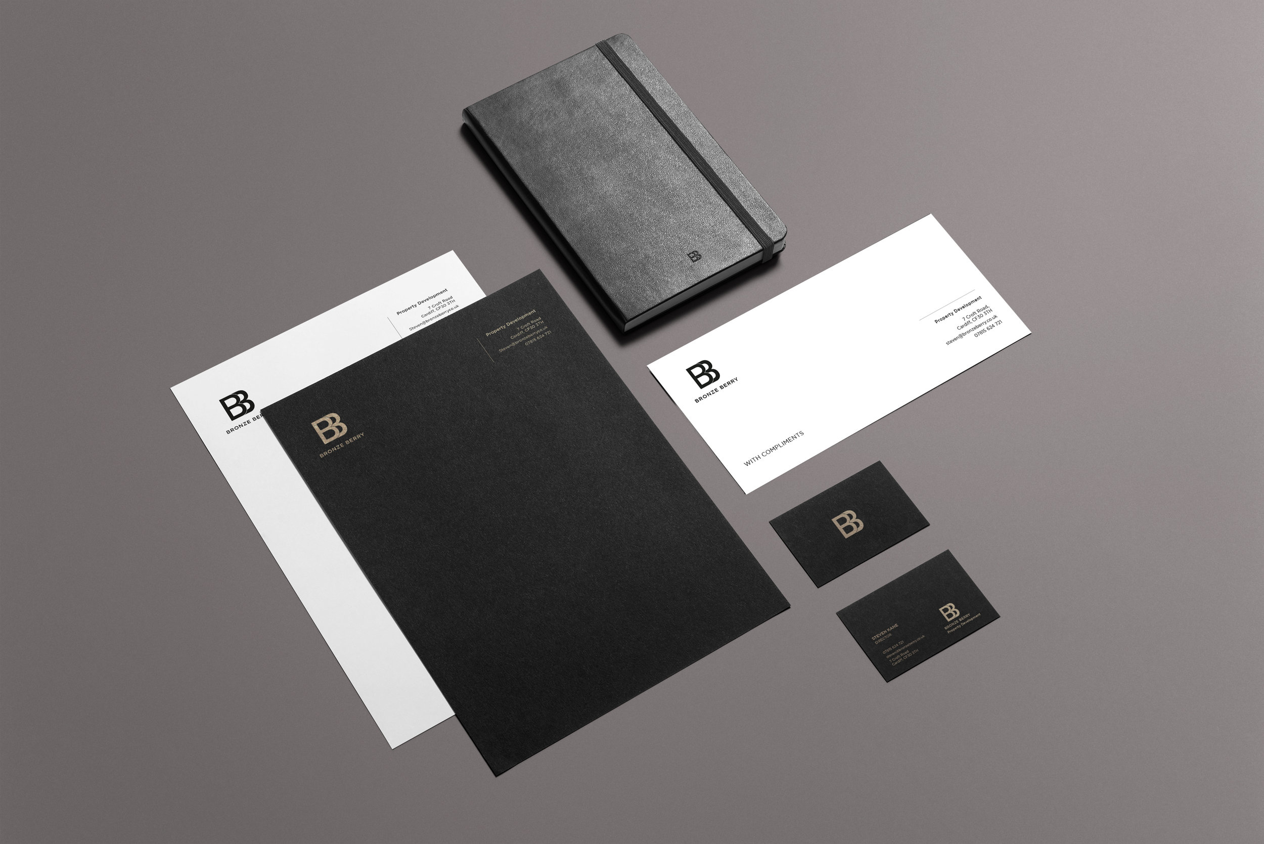 Luxury foiled brand collaterals in black