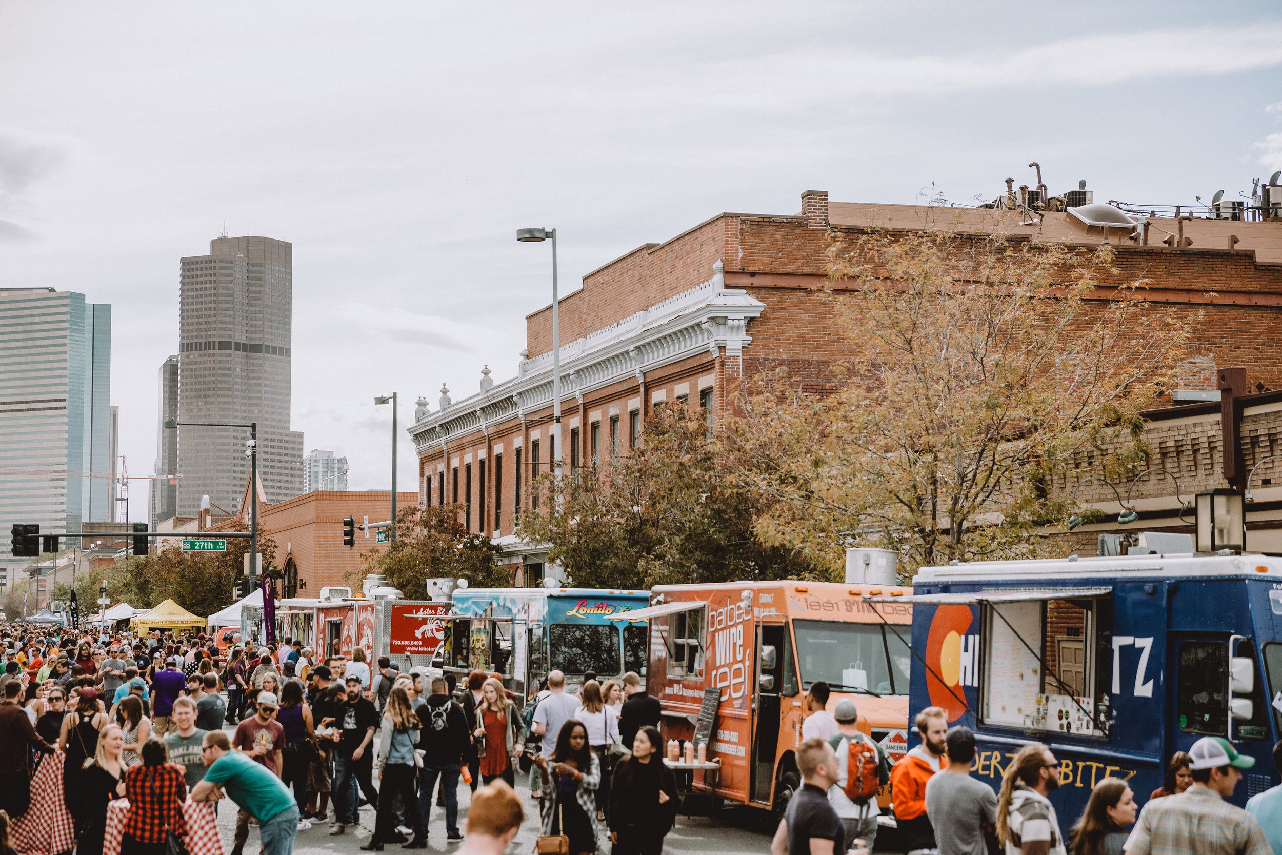 TRUCKS - Dozens of local food trucks lined Welton Street proudly serving thousands of people everything from pizza and burgers, to seafood and international cuisine. A token system kept lines short and fast, so no one was left hungry!