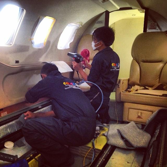 workers in plane.jpg