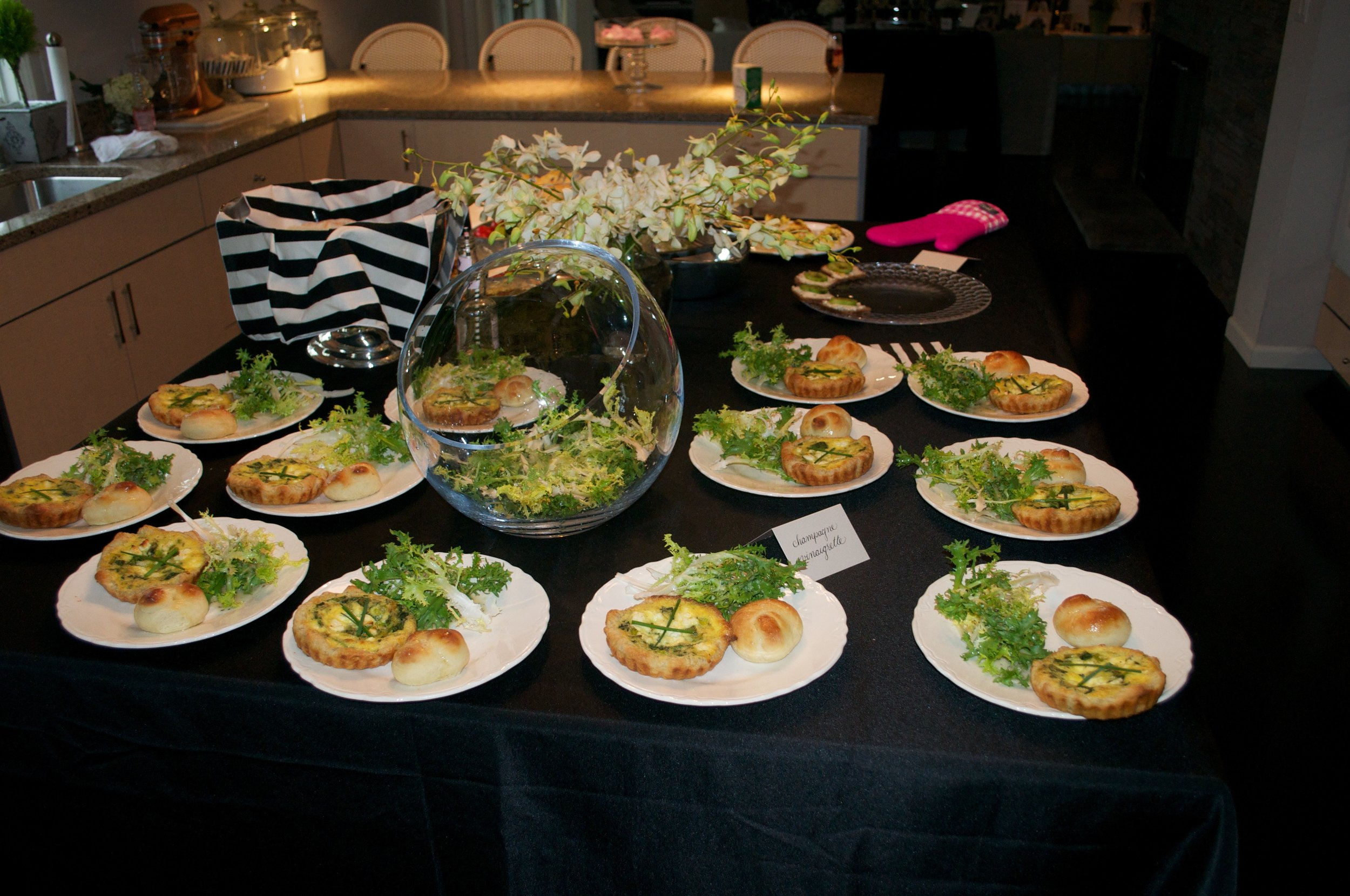 Mini gruyère quiches and garlic knot rolls with frisée salad and champagne vinaigrette