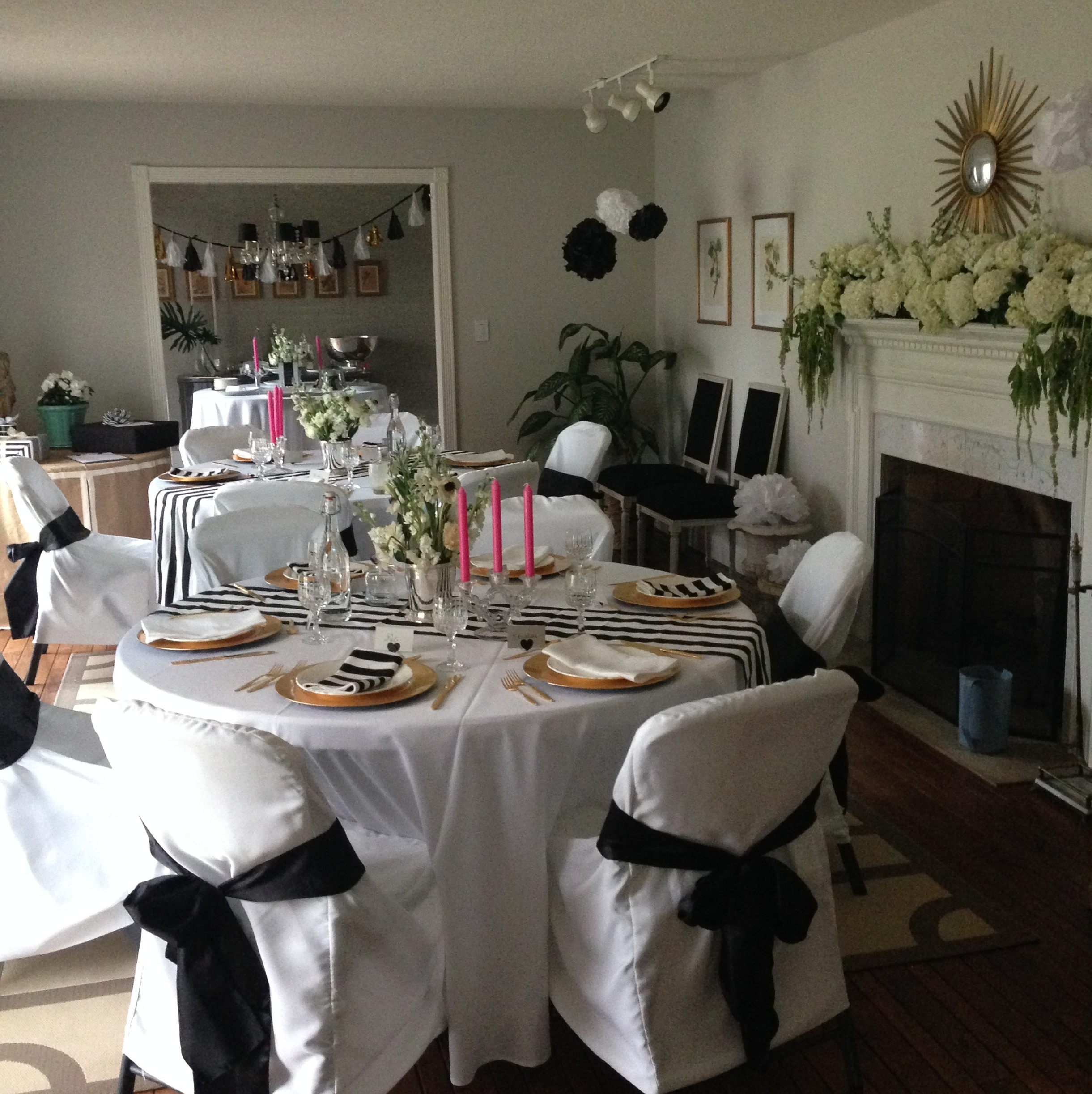 Tables set with gold flatware, white china and crystal