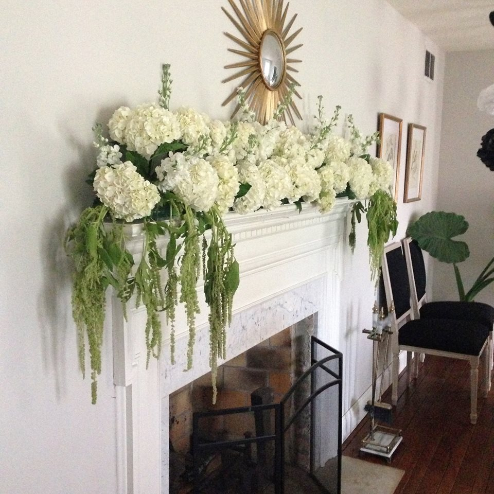 The mantle, dripping in green amaranth, hydrangeas and stock