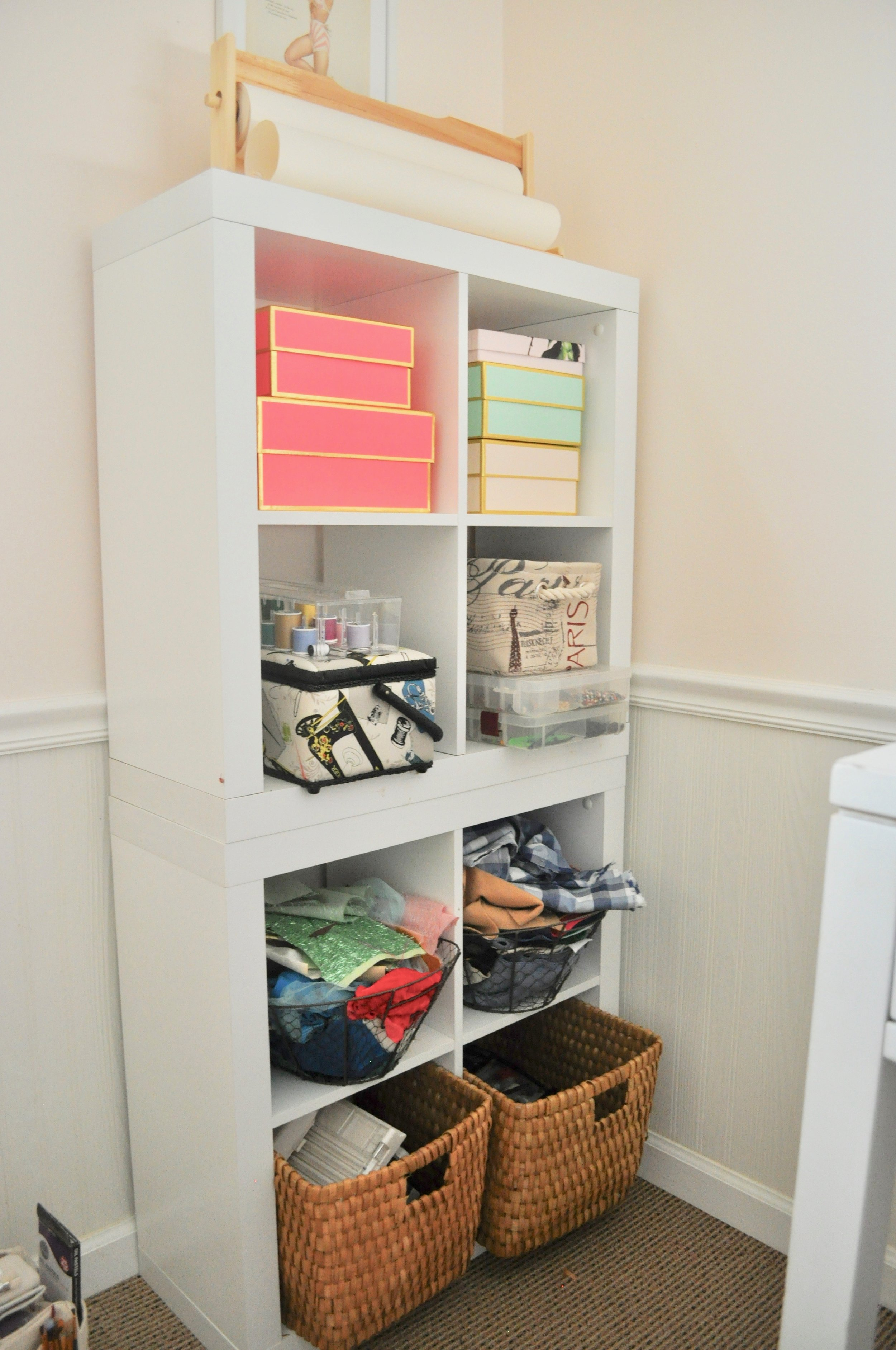 Two 4-cube organizers stacked into a tower, holding a variety of sewing and fabric supplies