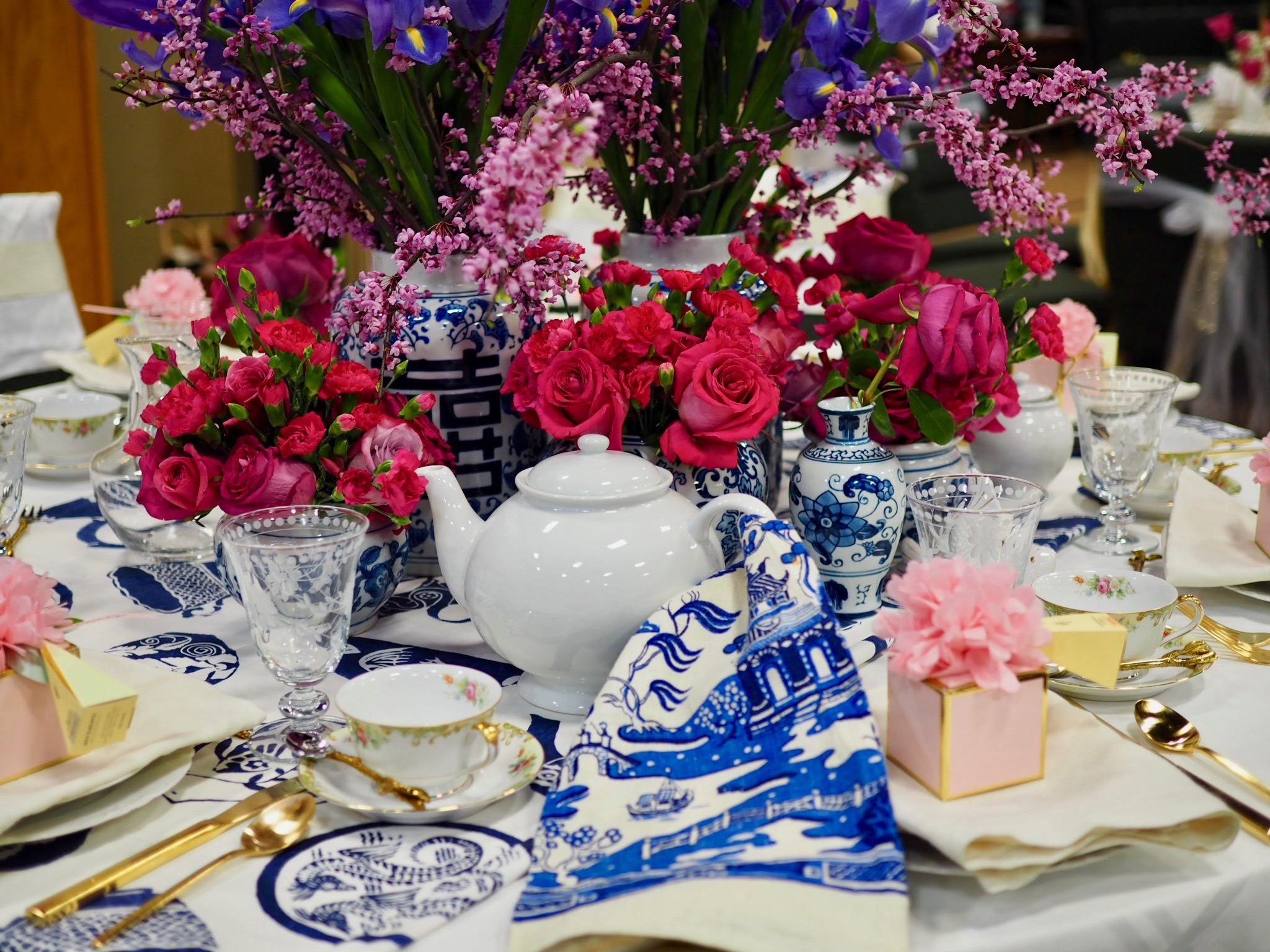 Teapot with a vintage blue toile tea towel