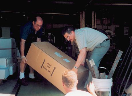 Sal Baglieri, Ed Kulahli and Ziggy Przybylo load Power Hawk rescue equipment destined for Ground Zero