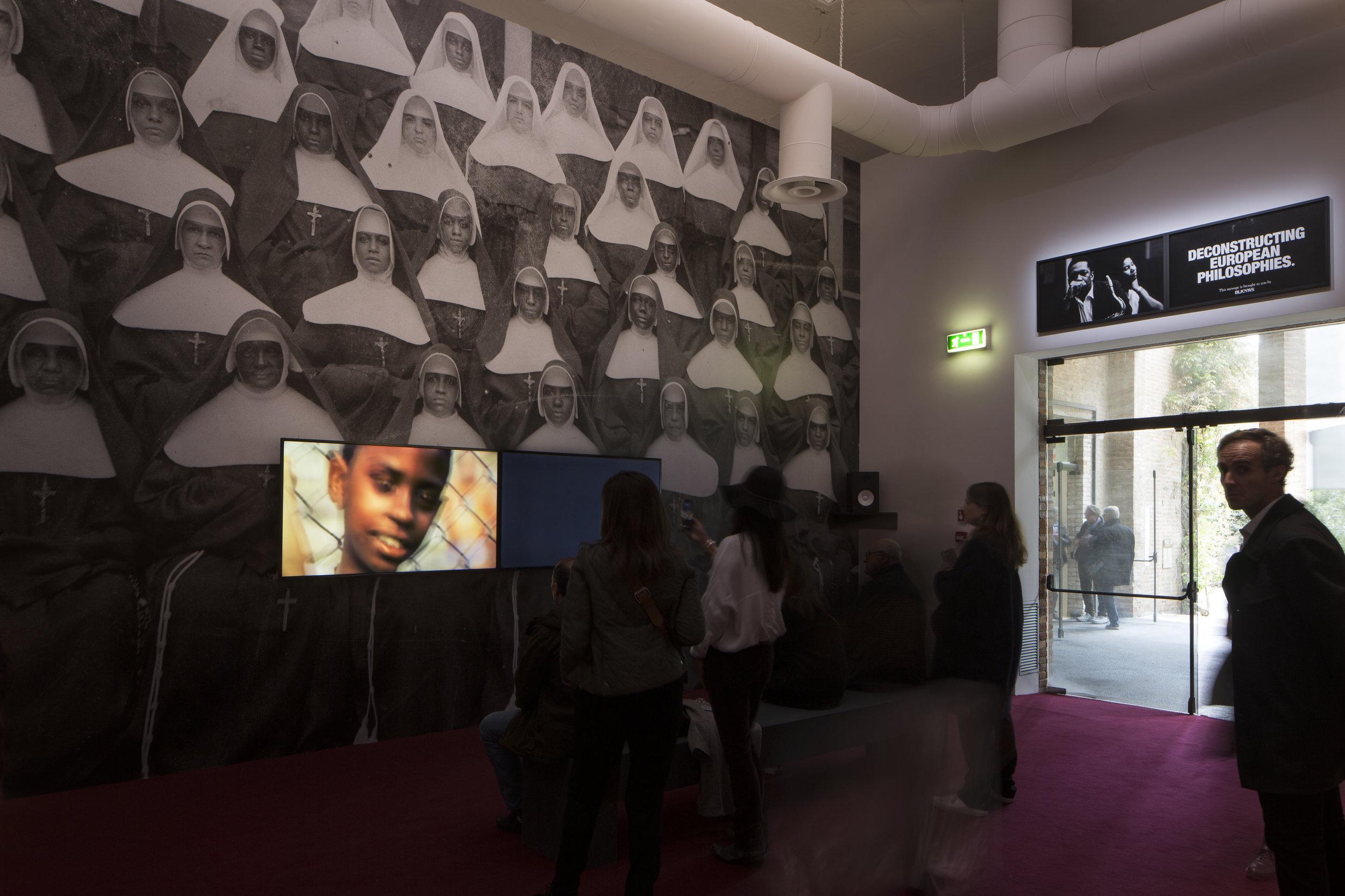 Installation view of  BLKNWS  (2018 - ongoing) by Kahlil Joseph, in Giardini. Courtesy of the artist and La Biennale di Venezia.