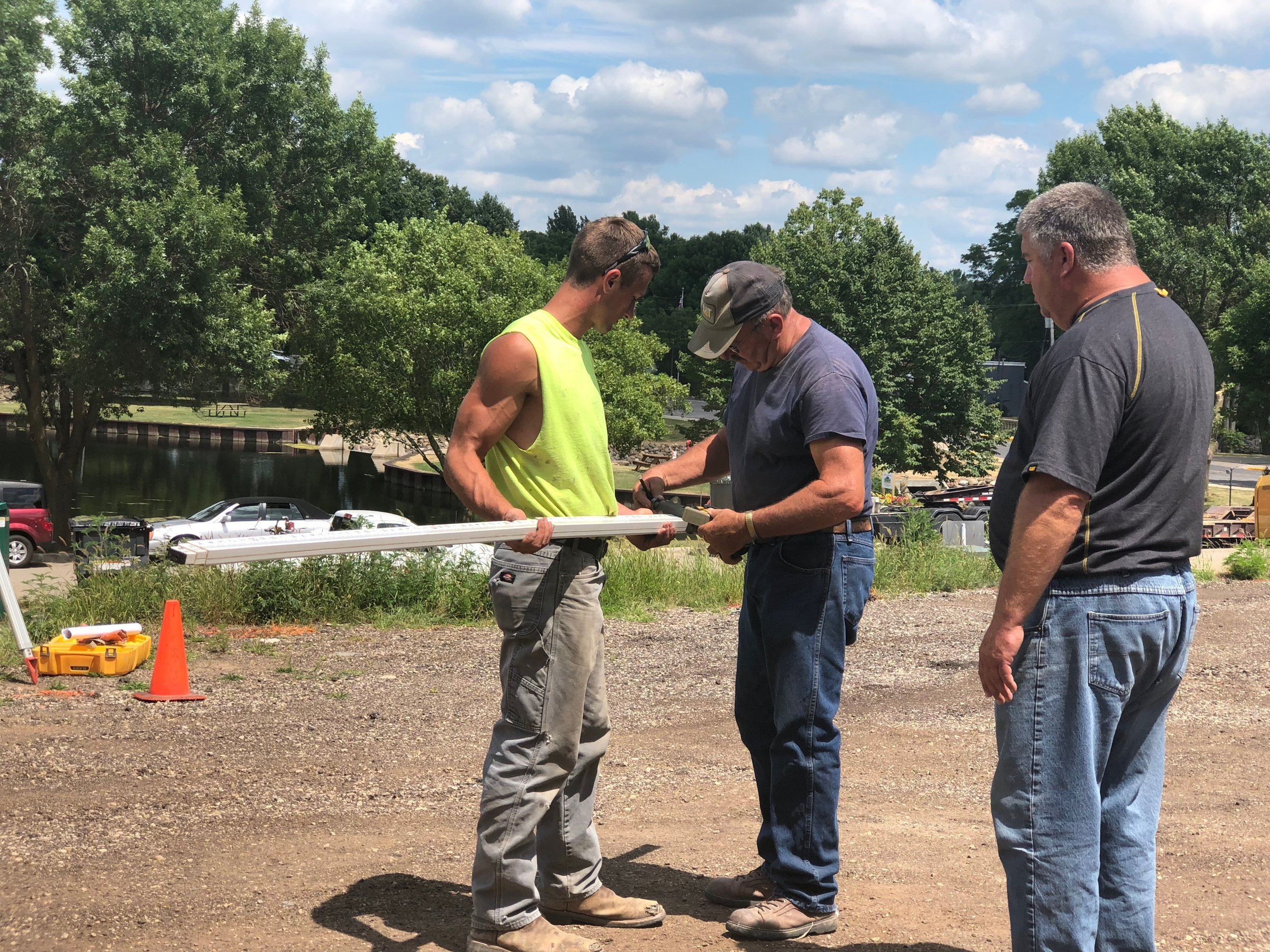 Contractors Blake Brecheck, Dan Pollesh and Bill Kinas of Kinas Excavating confer during construction at the Mill Pond Terrace site