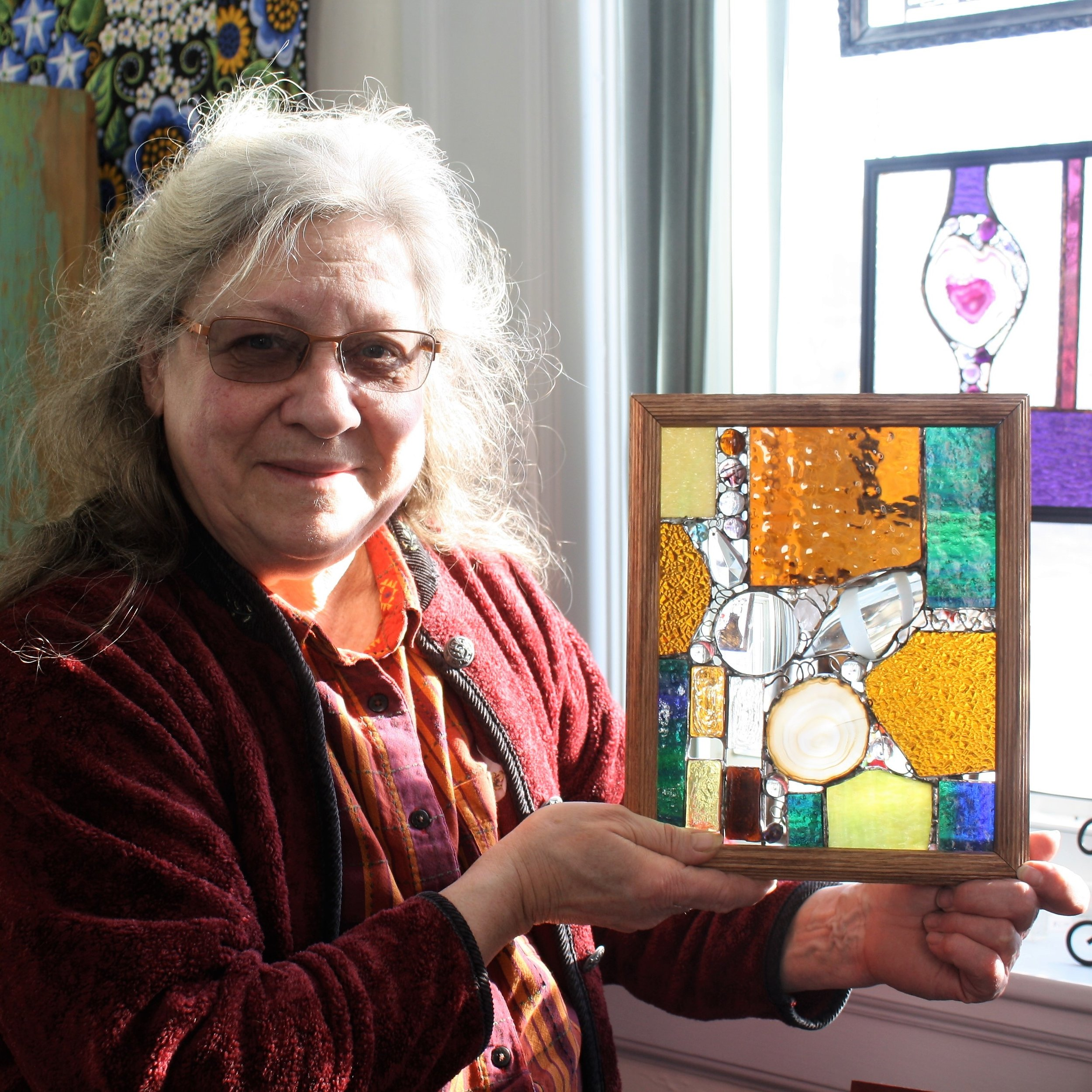 Artist Donna Marquart is well known for incorporating found objects into her glass work..JPG