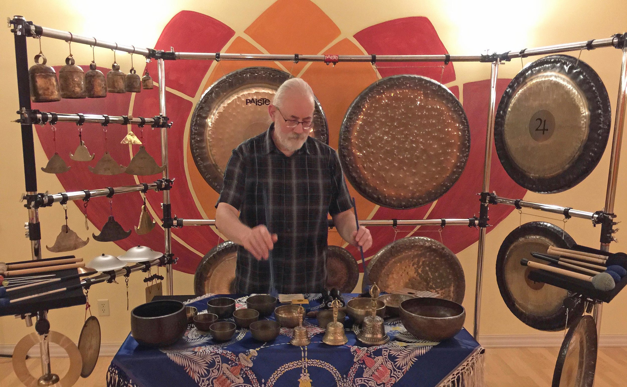 Michael uses a large collection of resonating metal instruments that he has collected over the past 40+ years.