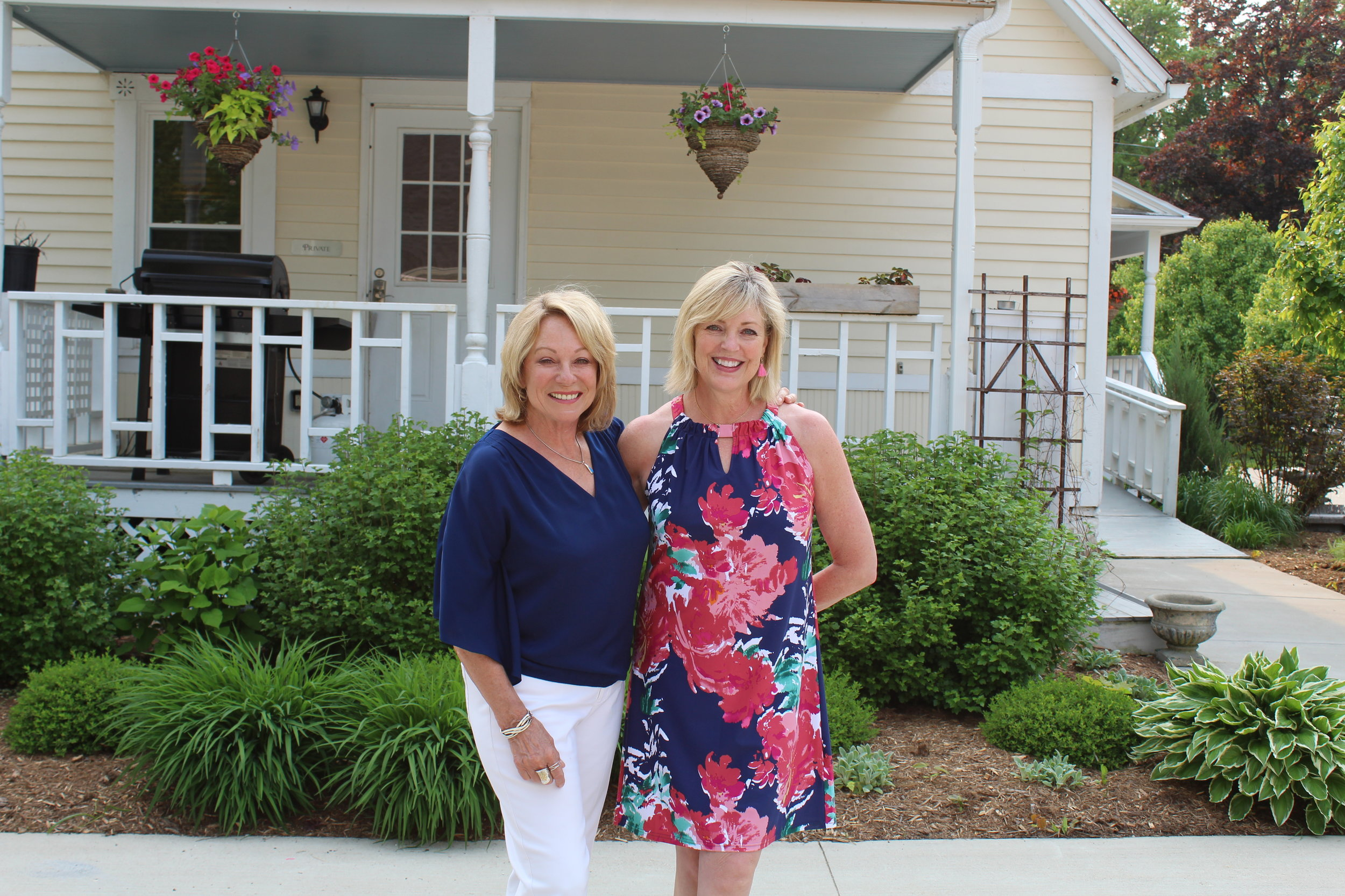 Hosts Joan Lloyd and Jo Ellen Madden greet guests in front of the Greenway House Bed and Breakfast in Green Lake.