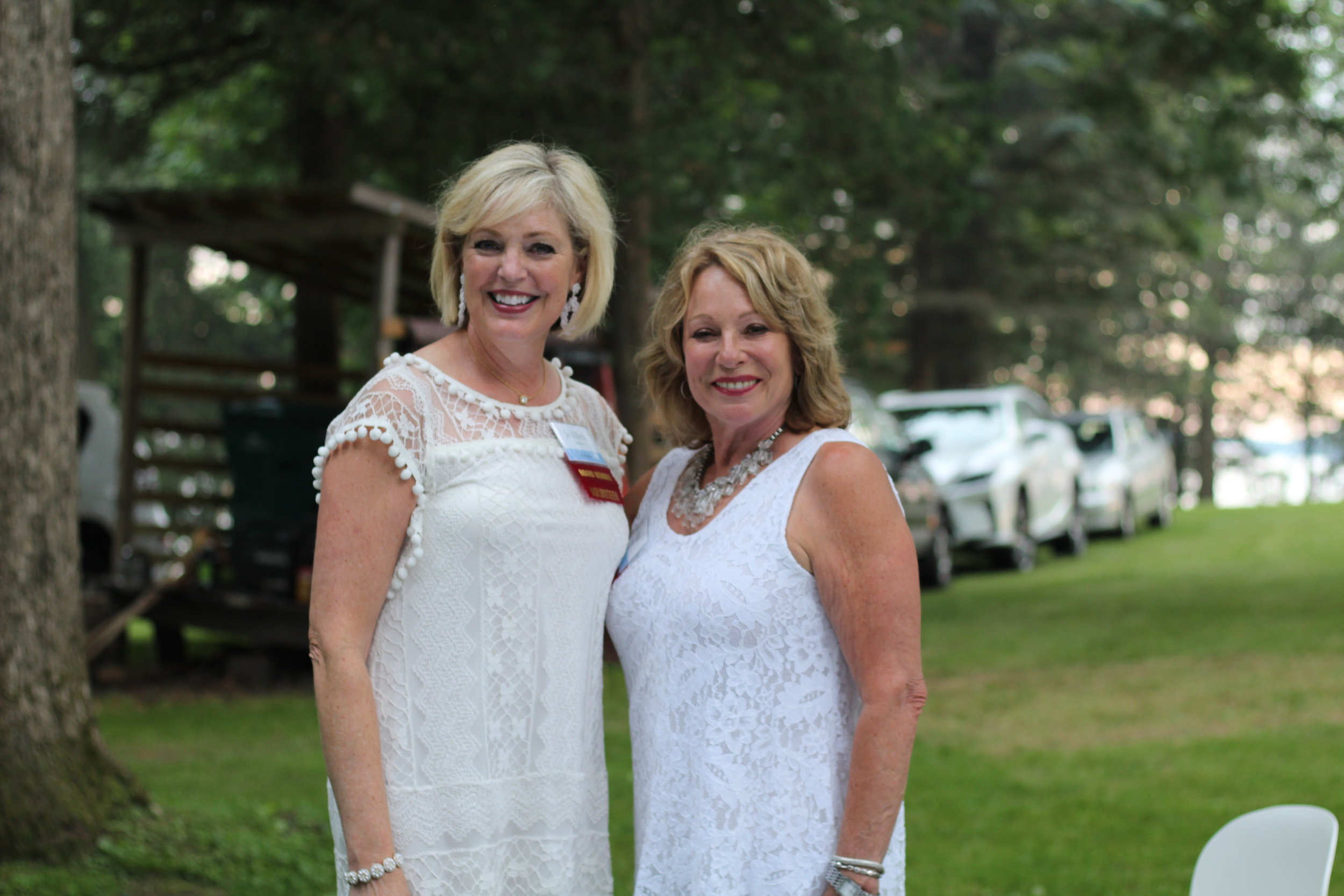 White Hot Party Co-Chairs Jo Ellen Madden and Joan Lloyd organize yet another successful fundraiser to benefit the projects of Town Square Community Center.
