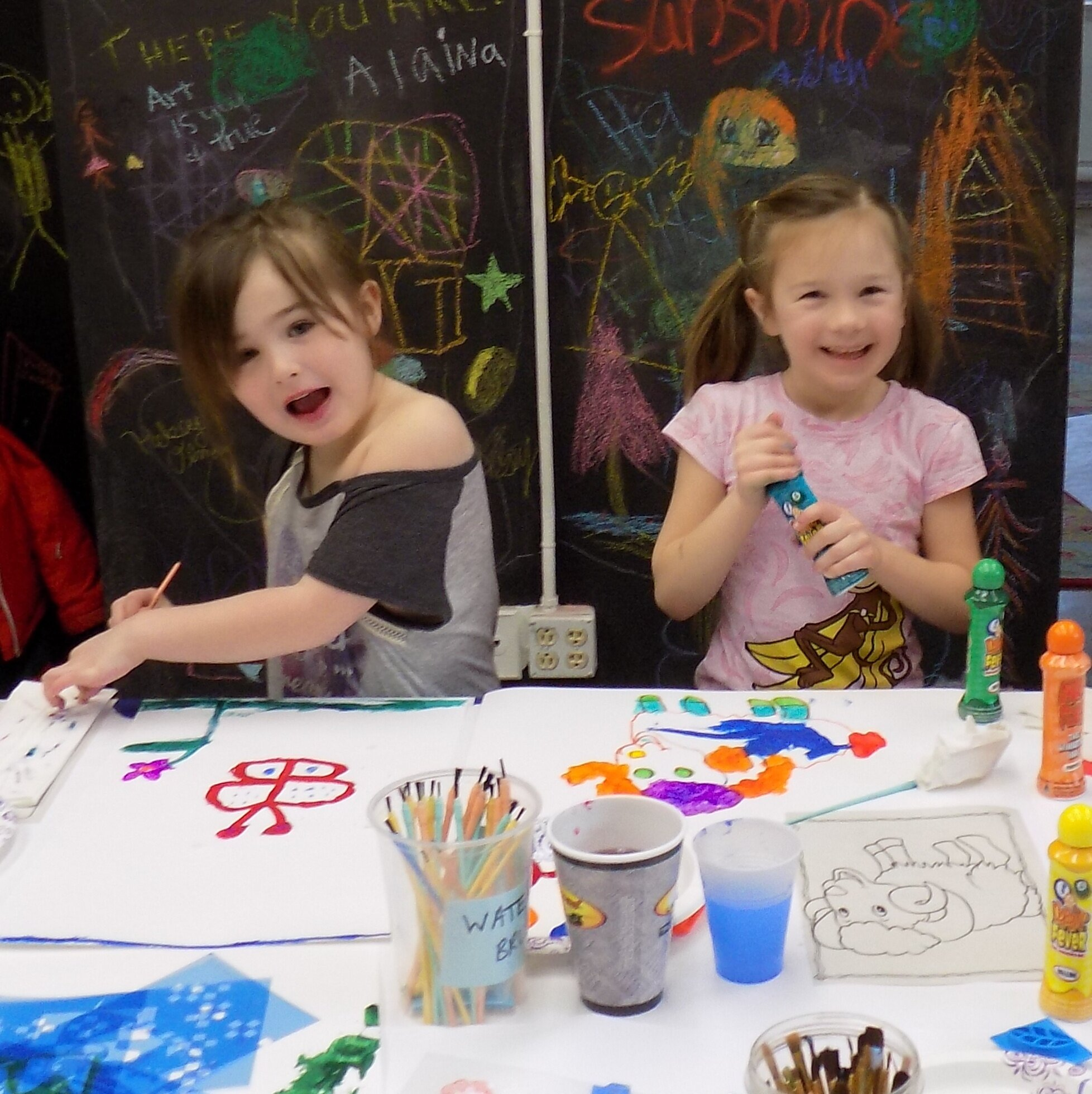 Isabelle Loberg and Sadie Nolen painting in one of Kathy McLaughlin's workshops for kids.