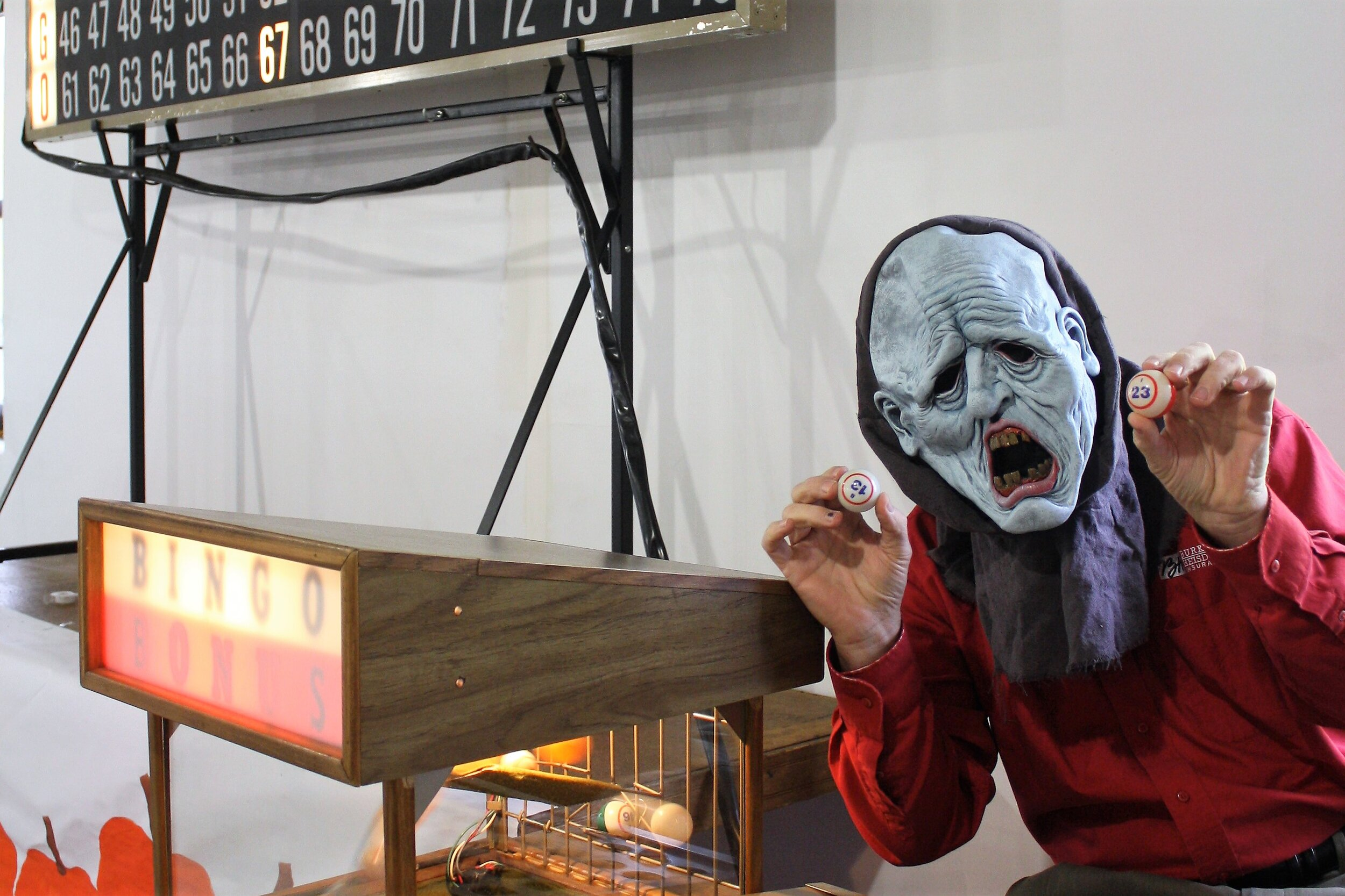 Bingo caller Phil Burkart calling upon the Bingo Beings of the beyond for good luck and fortune at Spooktacular Bingo.