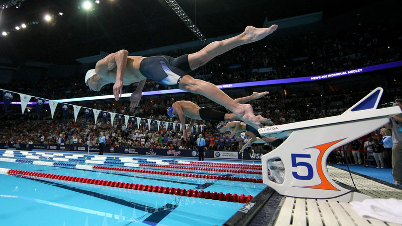 Researchers studying brains want to know what's happening in an area called the premotor cortex — the place in the brain that gears up for something the body is about to do, like swimming. Above, Michael Phelps dives off the starting blocks in the final heat of the men's 400-meter individual medley during the 2012 U.S. Olympic Swimming Team Trials in Omaha, Neb., on June 25.  Jamie Squire/Getty Images