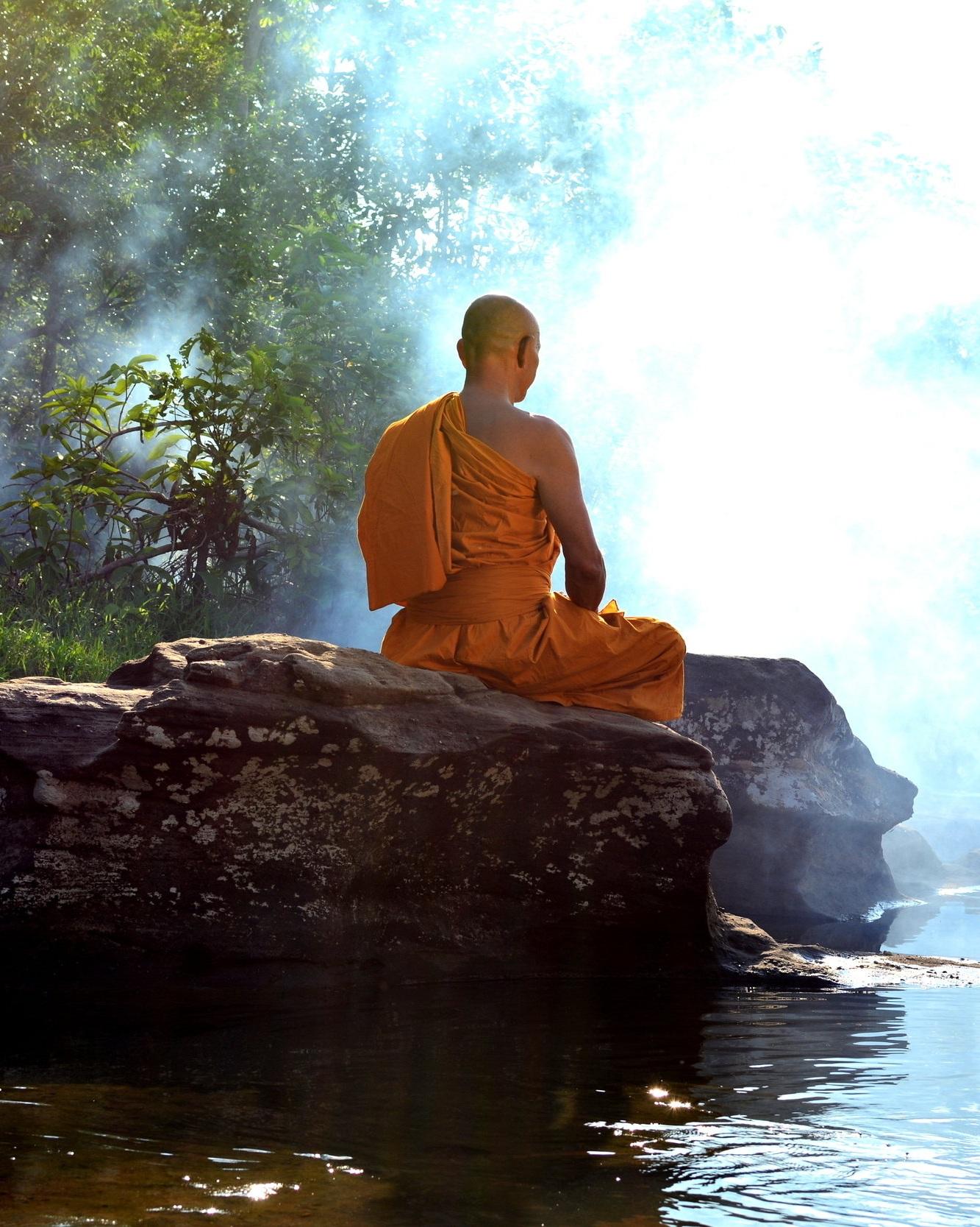 Buddhist+Monk+on+Rock.jpg