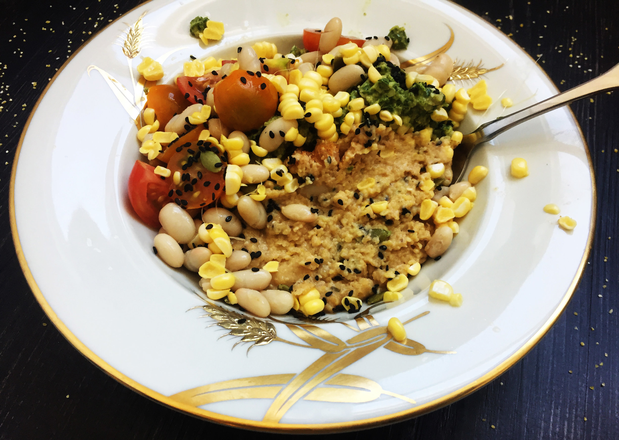5. To plate, spoon in 1/2 - 1/4 of the grits into a bowl, top with corn kernels, beans, pesto, and tomatoes.