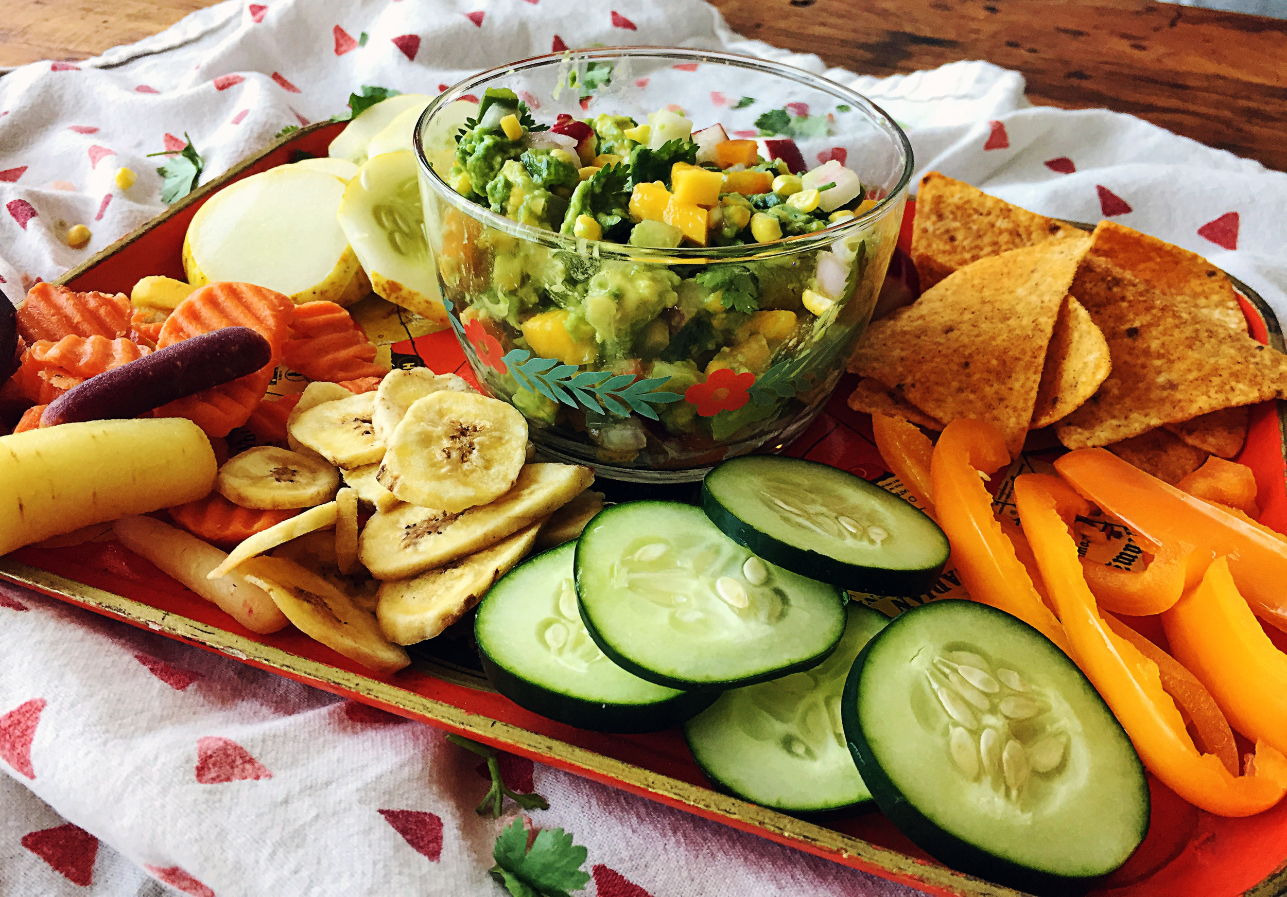 5. Serve guac in a nice dish with a spread of crudite. Some of my favorites are up above and provide a wonderful spread of healthy snacks to eat this treat. It is pretty tasty on its own as well.