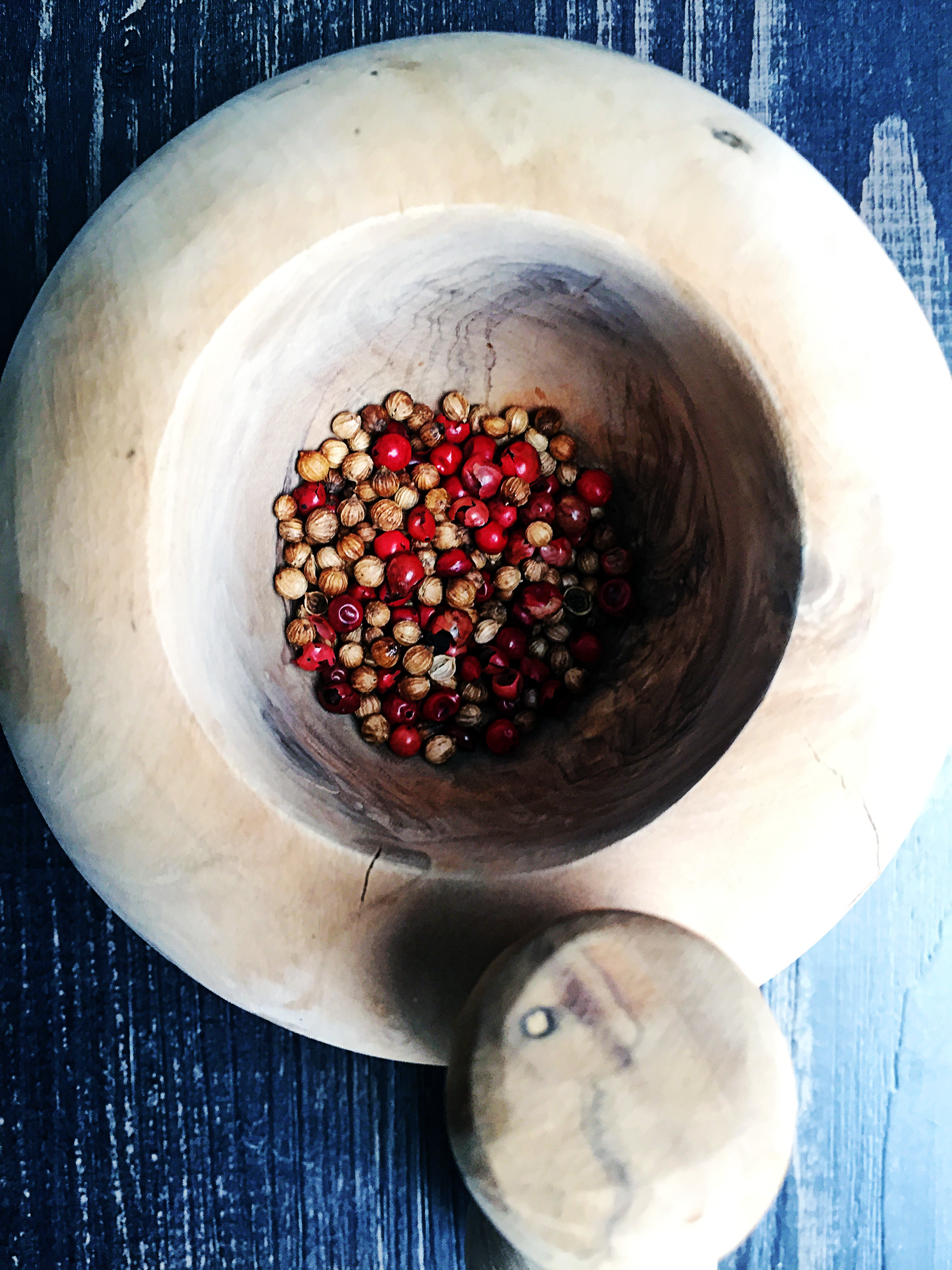 3. Take the toasted spices and place into mortar and pestle to grind it. If you do not have one, you can use a blender or food processor to break them down. You want to create a fine texture.