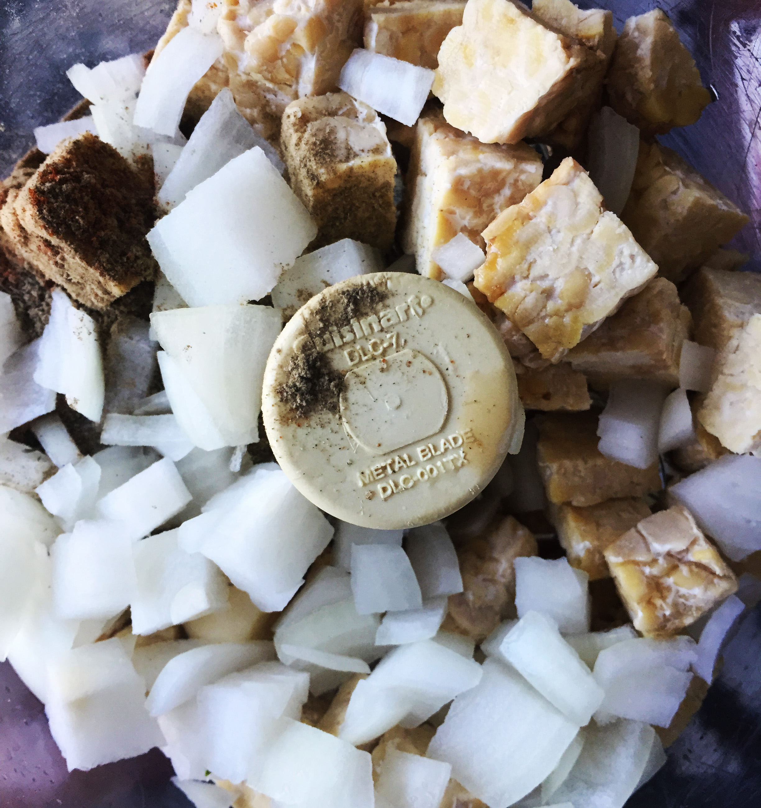 2. While onions cook, add all the sausage ingredients (sans oil) into food processor or blenders. Blend for 10 seconds until well mixed like a ground beef consistency.