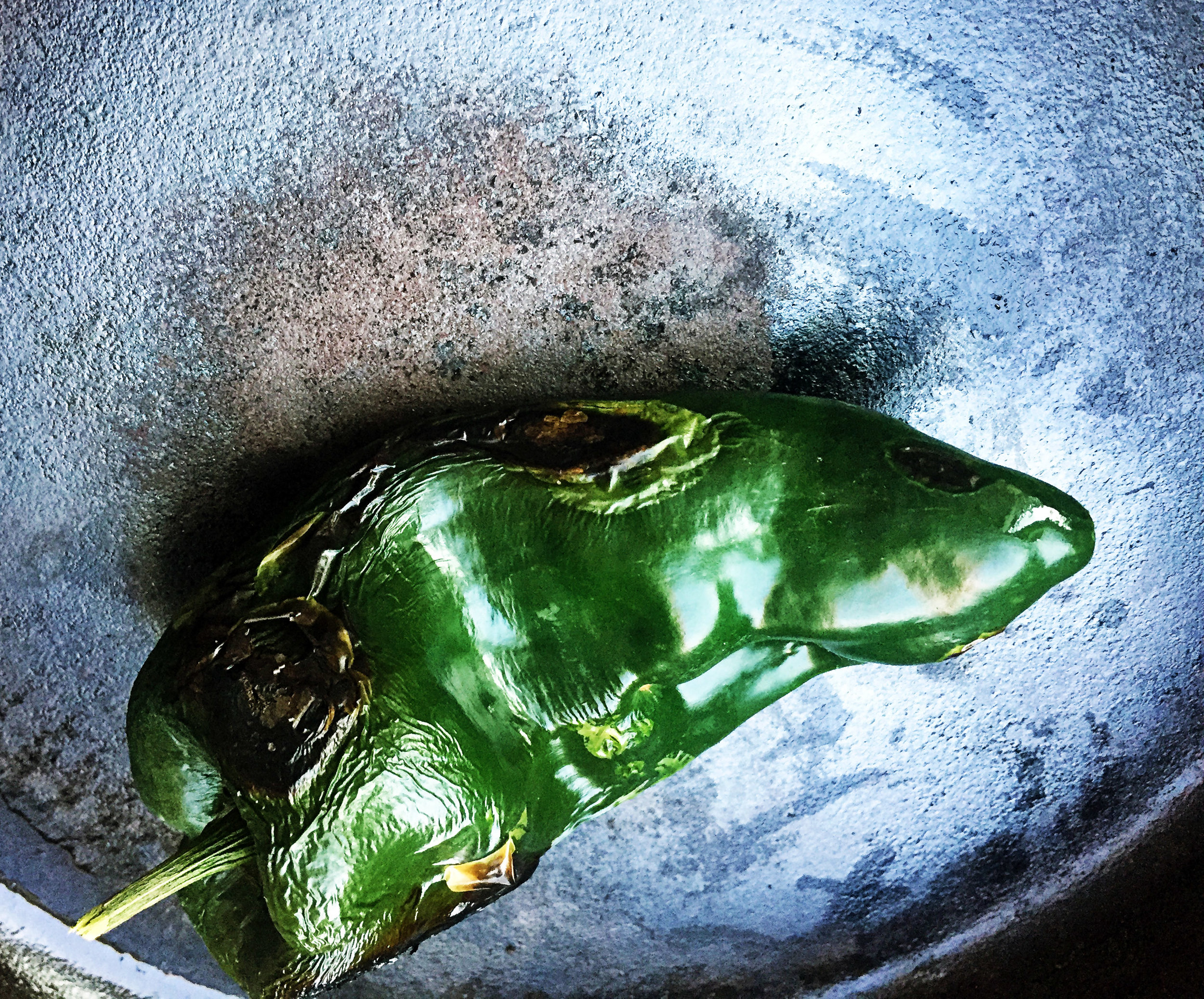 2. Add poblano to a dry castiron or regular pan over medium-high heat. Char on each side for 2-3 minutes and rotate until have good char on each side. Use a dishcloth to handle. Be careful!
