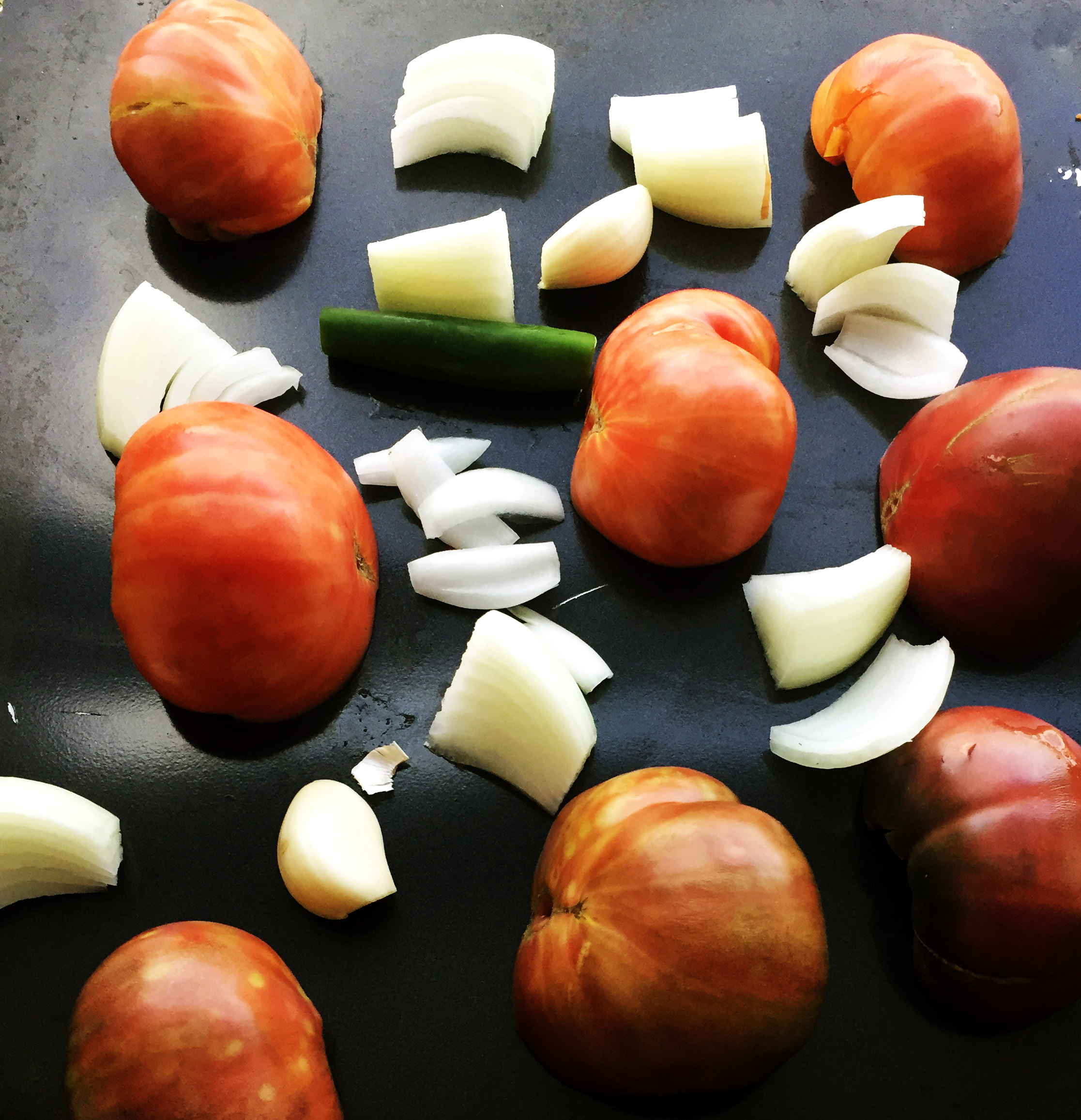1. Place veggies for salsa on a baking sheet and place into oven set on broil (525) for 10 minutes.
