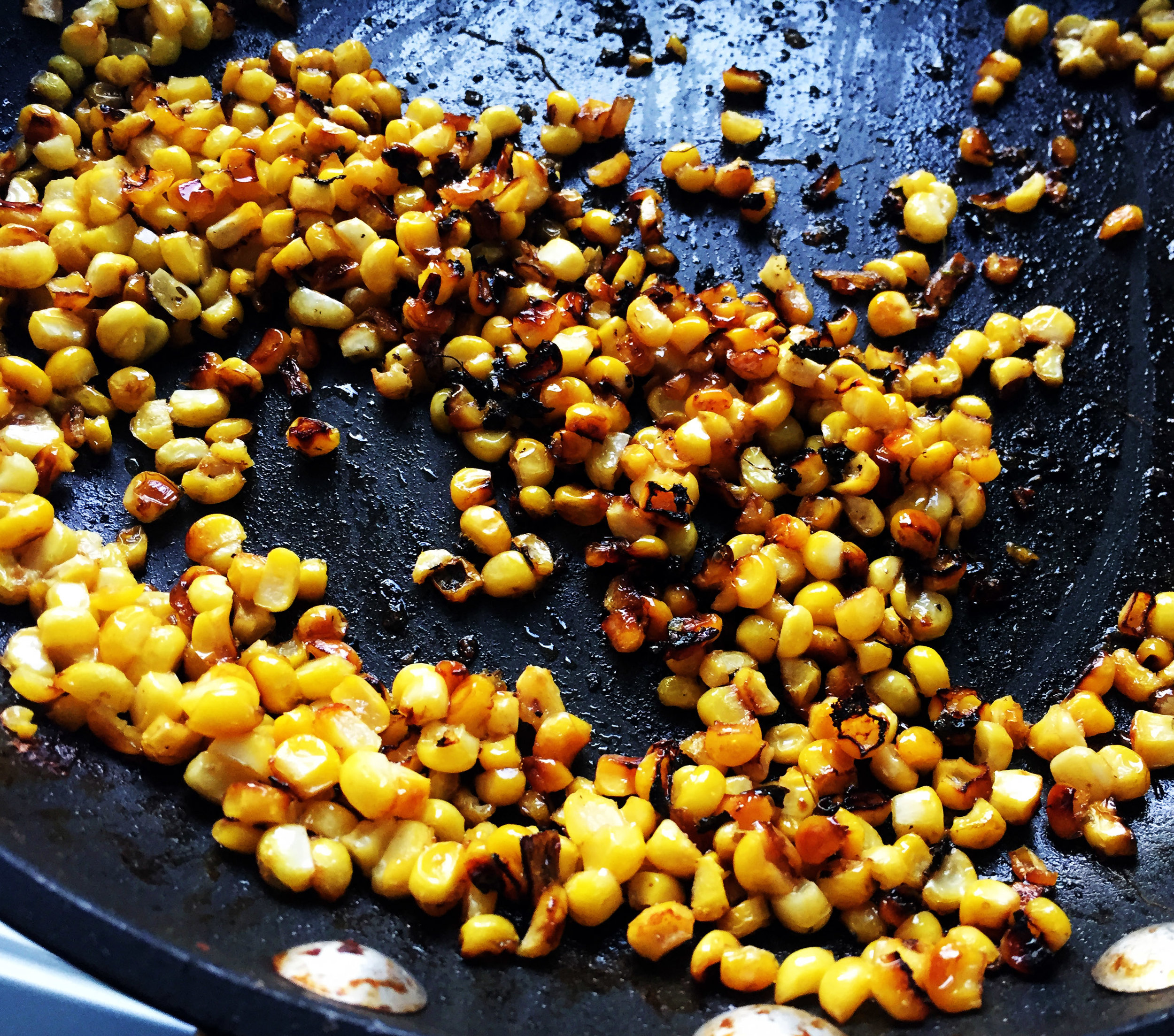 6. In another pan or same pan if the veggies are done, mix the corn, lime, and butter together and saute over medium heat for 8 minutes until it starts to brown.