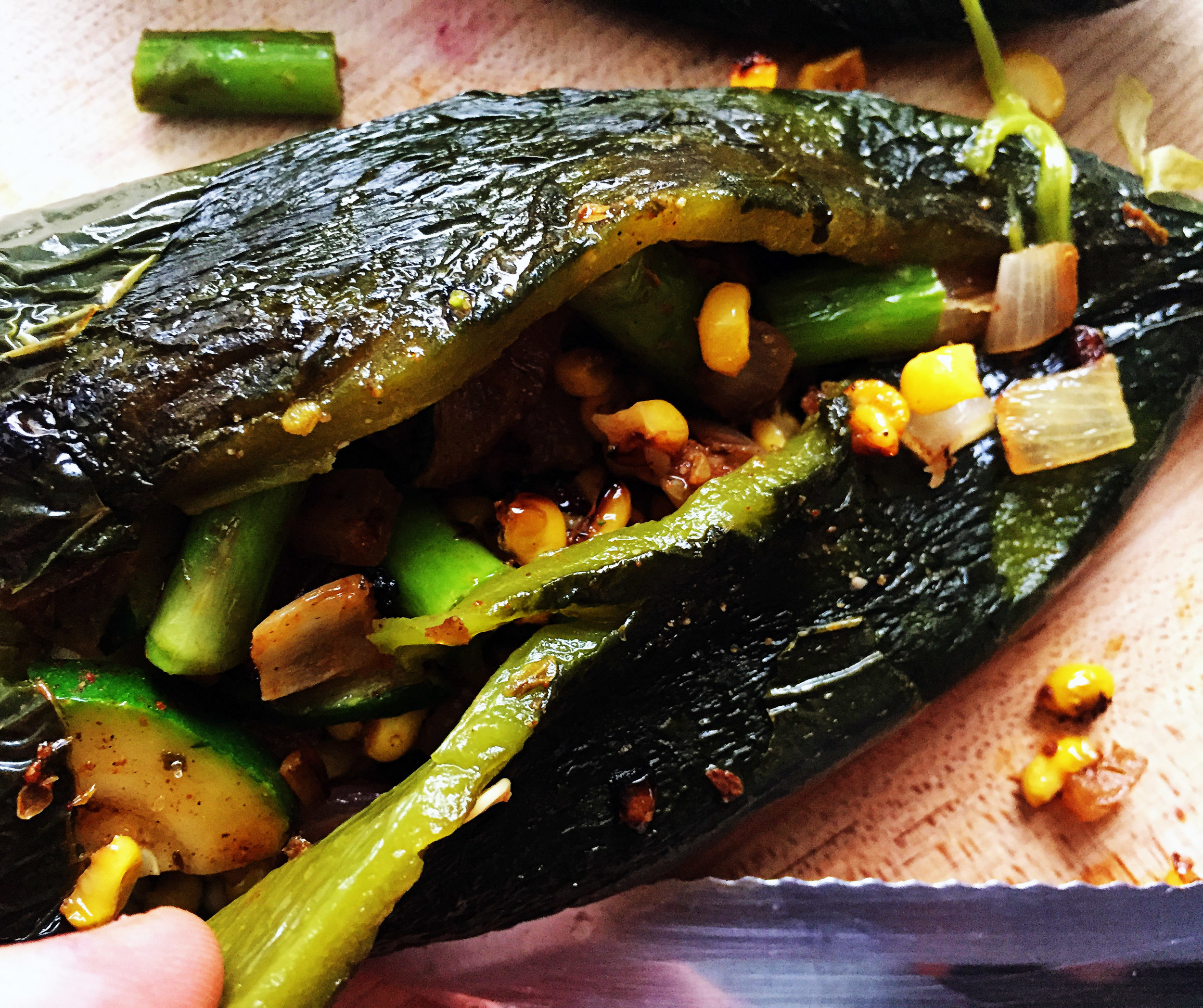 8. Stuff in the lime corn, zuke, asparagus mixture with a spoon. Be careful not to split it too much in the middle.