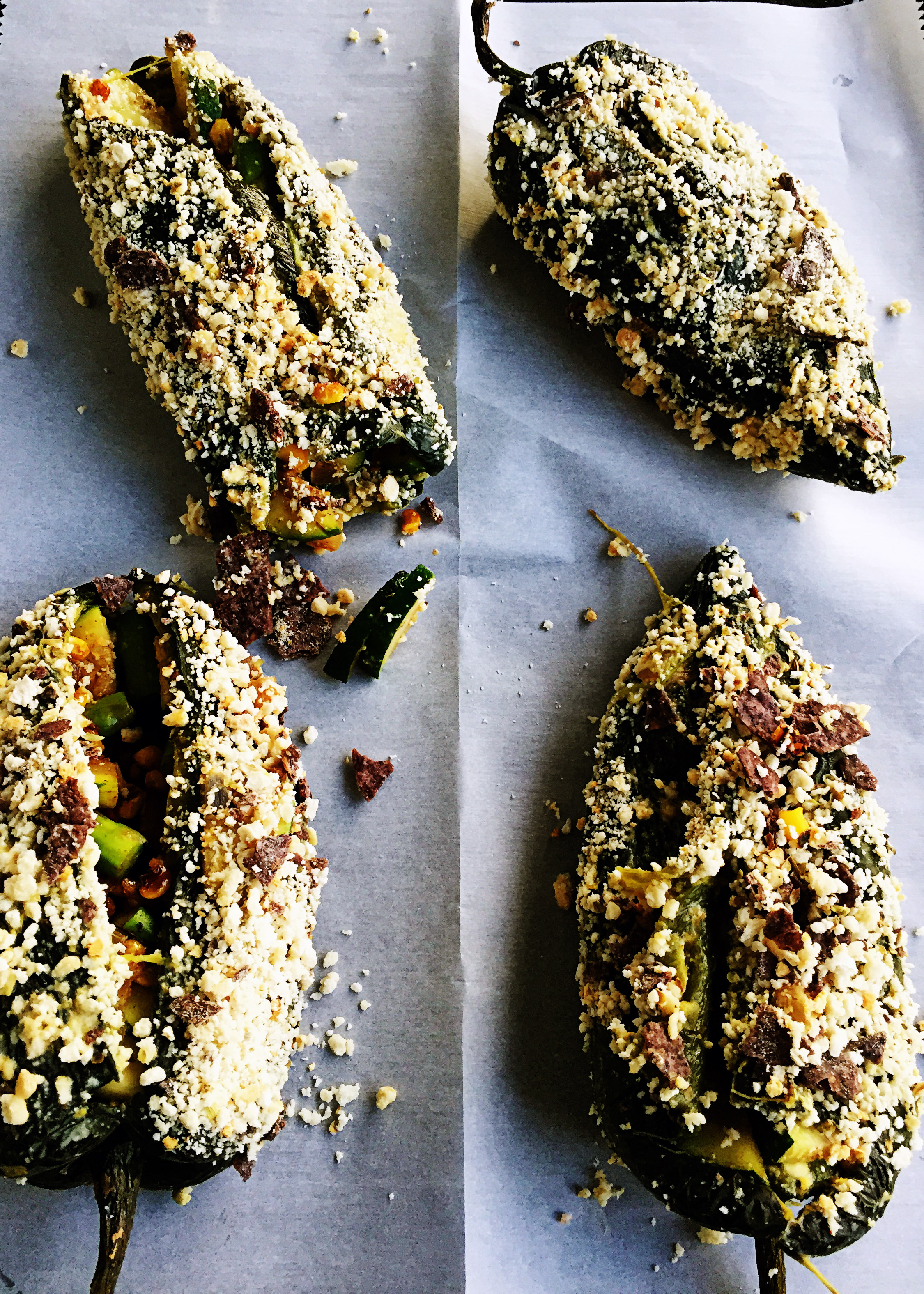 10. Last step - place each poblano in the bath and rotate to coat it well. Then coat it with the breadcrumb + spice mixture. Place in the oven at 350F and cook for 5-6 minutes to warm and cook the breadcrumbs on.