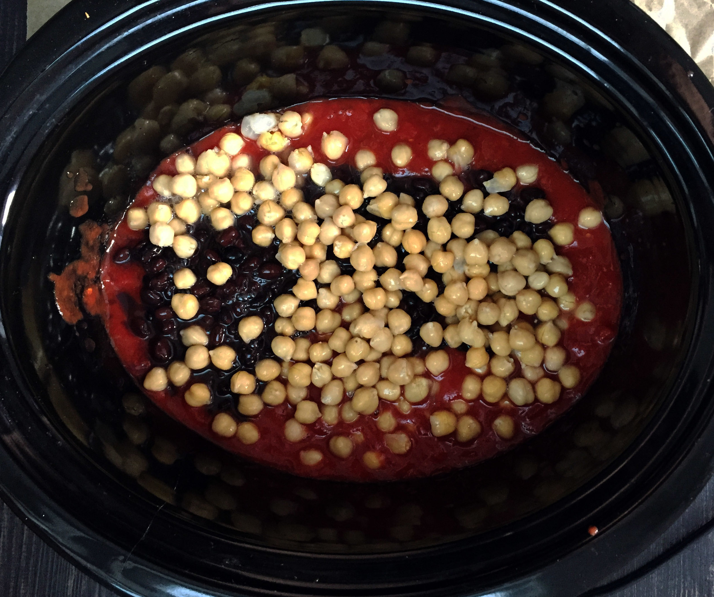 2. Add tomatoes and beans to the slow cooker.