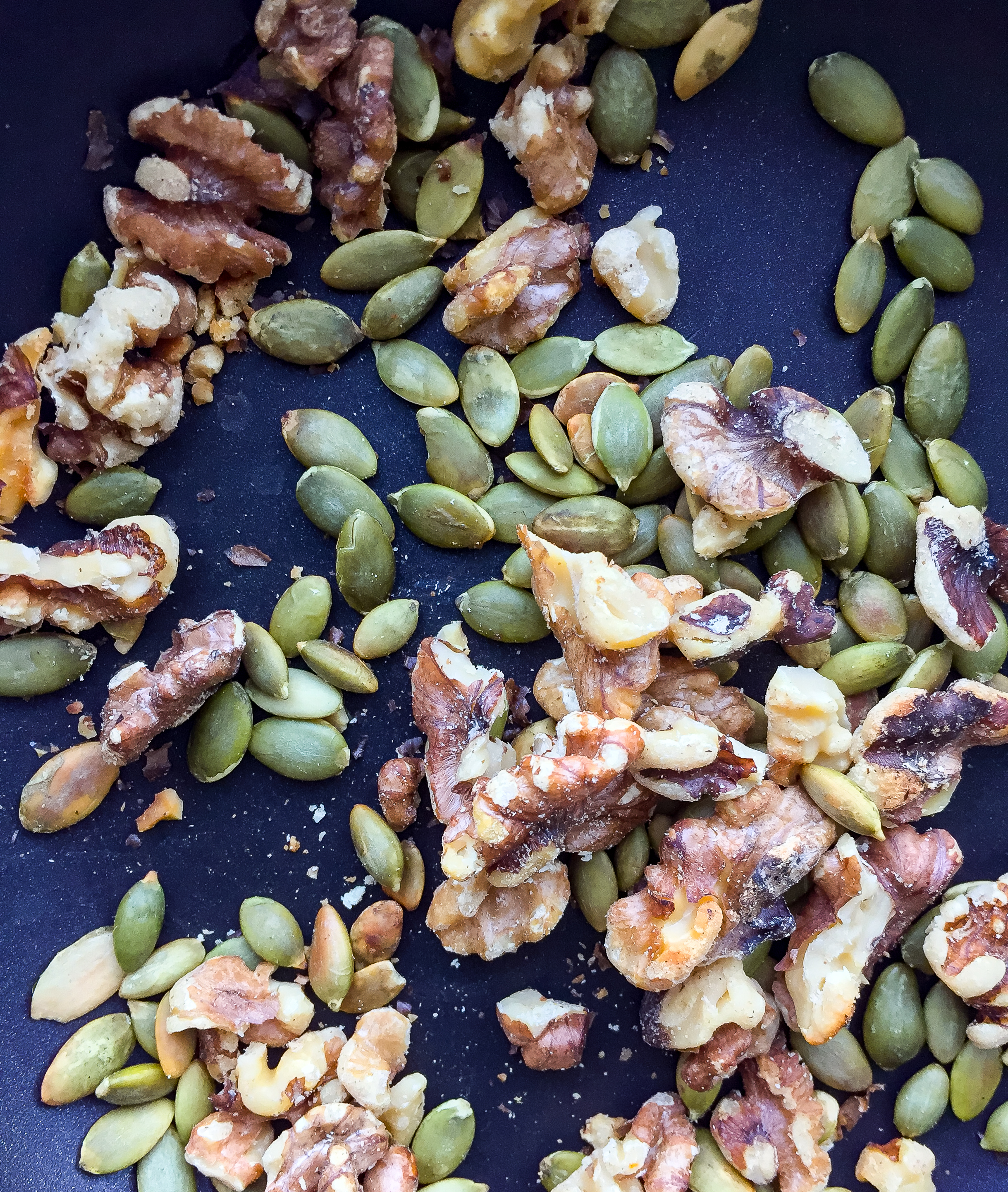 2. While that cooks, toast the walnuts and pumpkin seeds in a dry pan for 4-5 minutes on medium heat, rotating fairly often.