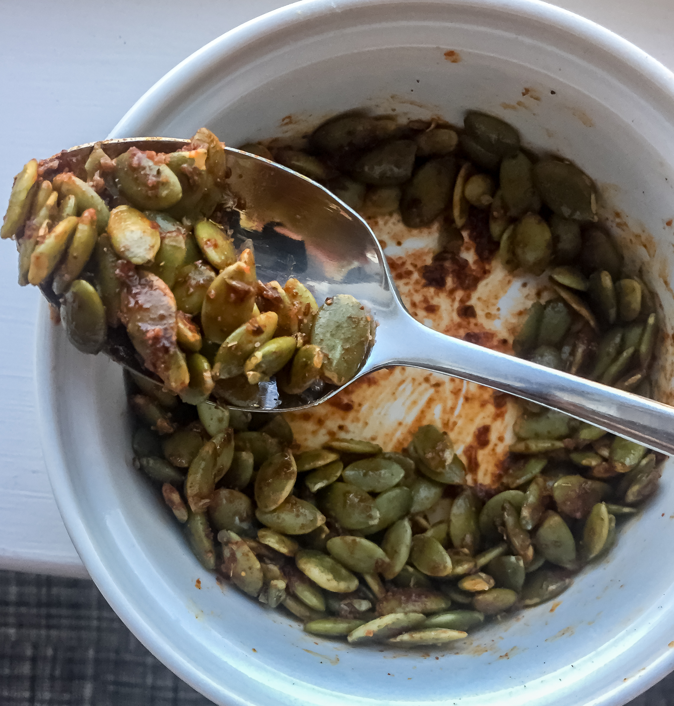 2. While that starts to cook or right before serving, heat the oil for the pepitas in a small pan for 60 seconds on medium heat. Throw in pepitas and spices. Cook for 3-4 minutes until nice and toasted.
