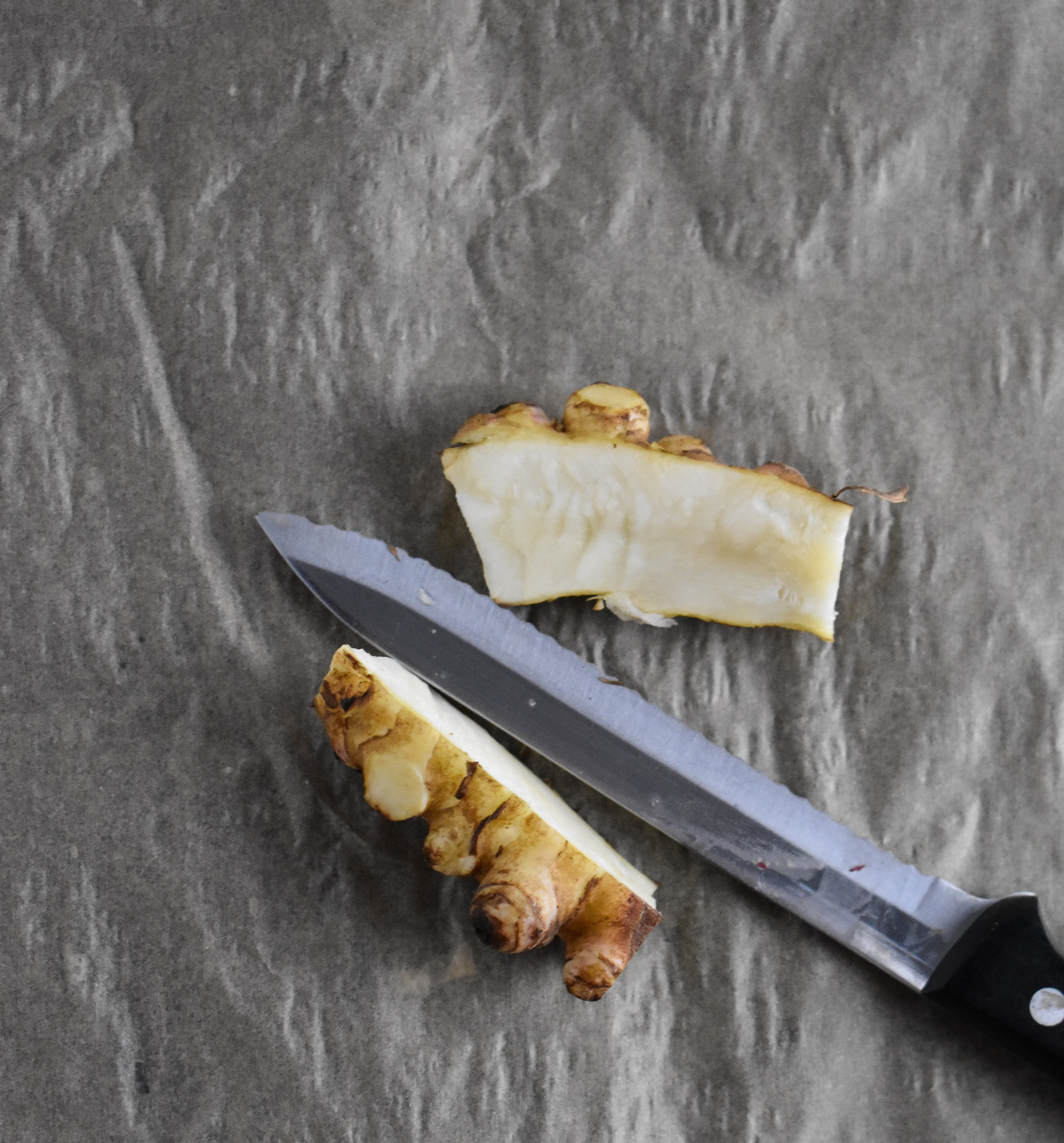 1. To dice the sunchokes, cut them just like potatoes. I like to slice them down the middle and then cut small cubes/squares from there.
