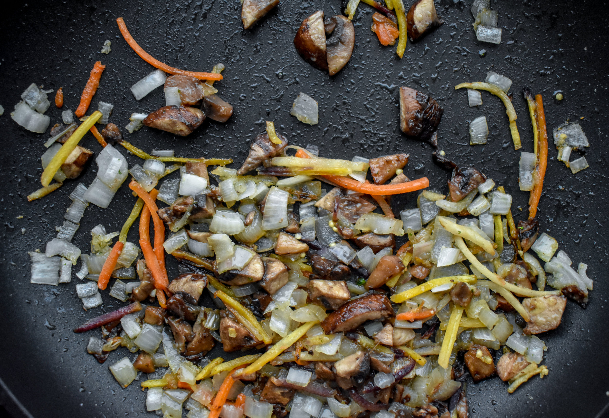 1. While the millet cooks, place mushrooms carrots, garlic and shallot in medium pan with 1 tbl of olive oil. Cook over medium heat for 5-6 minutes.