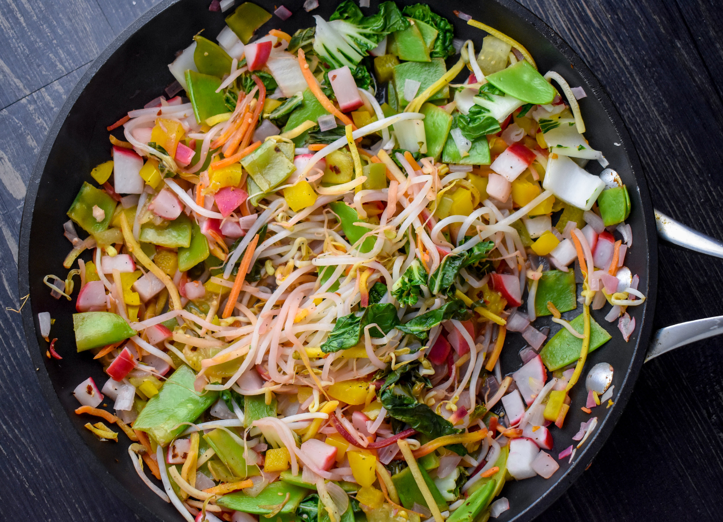 3. After potatoes are done, set them aside and add veggies to the same pan with a bit of sesame oil (1/2 tbl). Cook stirring frequently for 4-5 minutes to soften up veggies and warm them. I like to cook them until the bok choy is starting to wilt down.