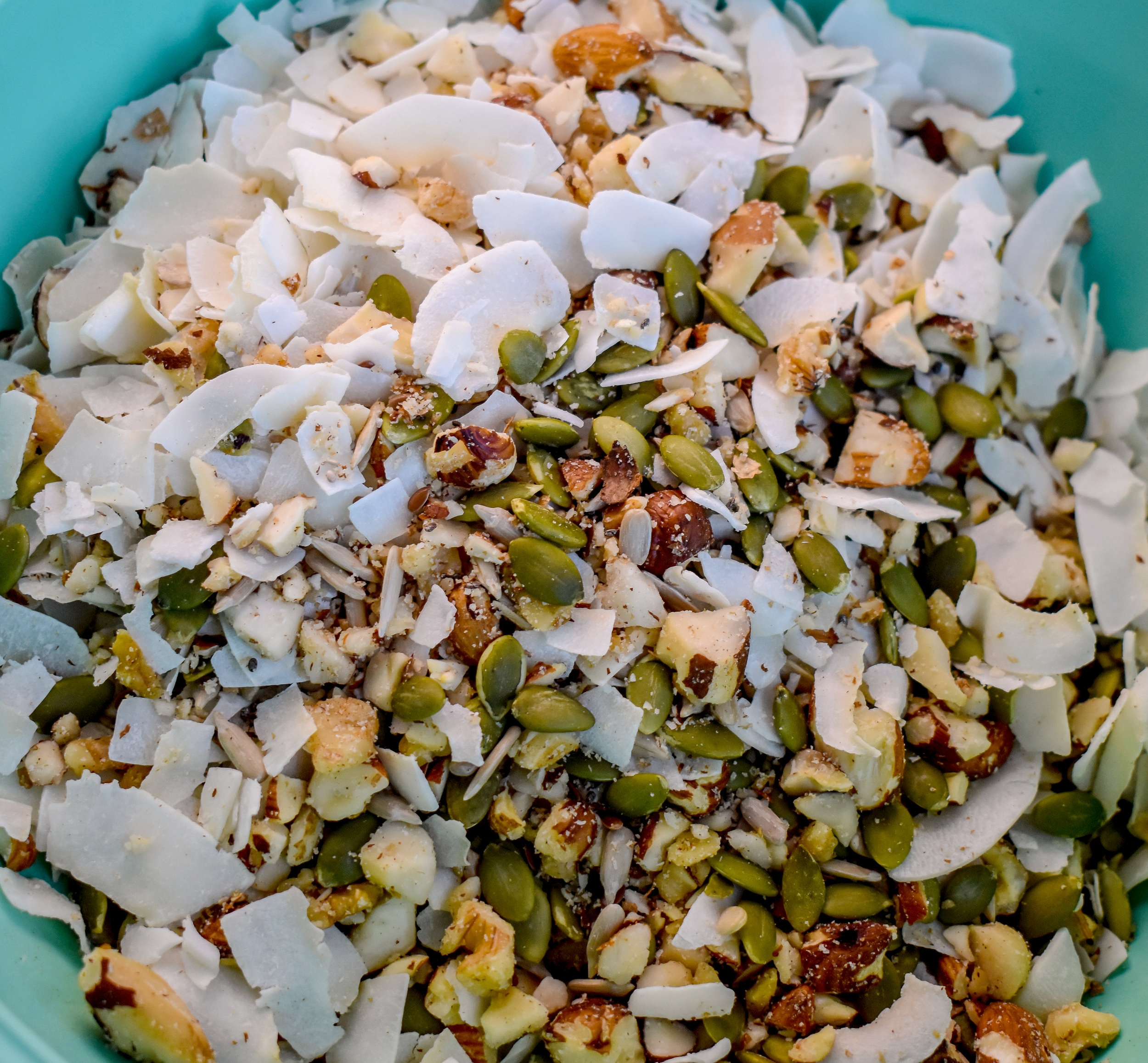 3. Add nuts to coconut flakes as well as the rest of the dry ingredients. Mix well.