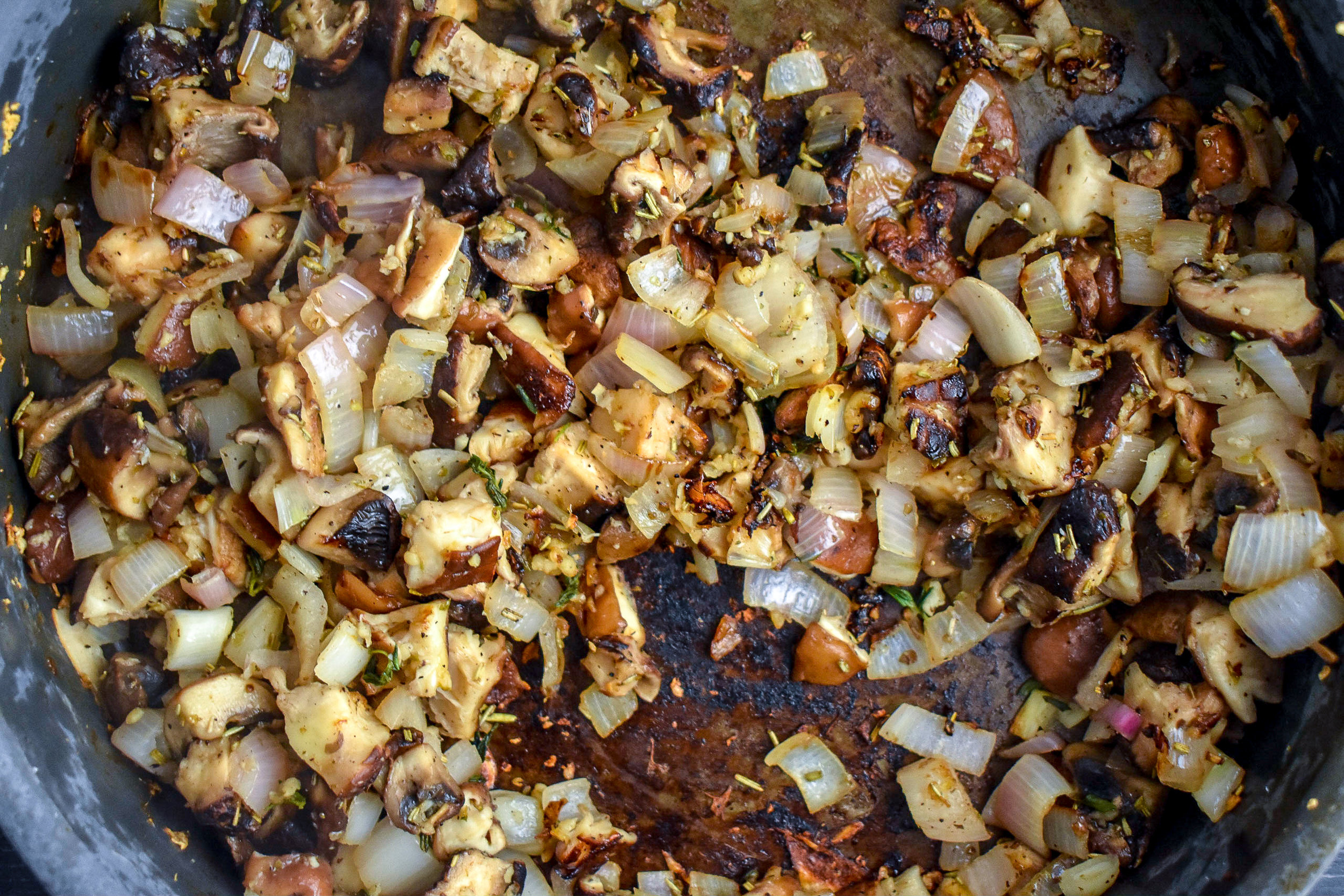1. Add vegan butter to large frying pan over medium heat. Once melted, add in shallots + garlic, cook for five minutes. Next, add in the chopped mushrooms and cook for another 2-3 minutes until it starts to soften.