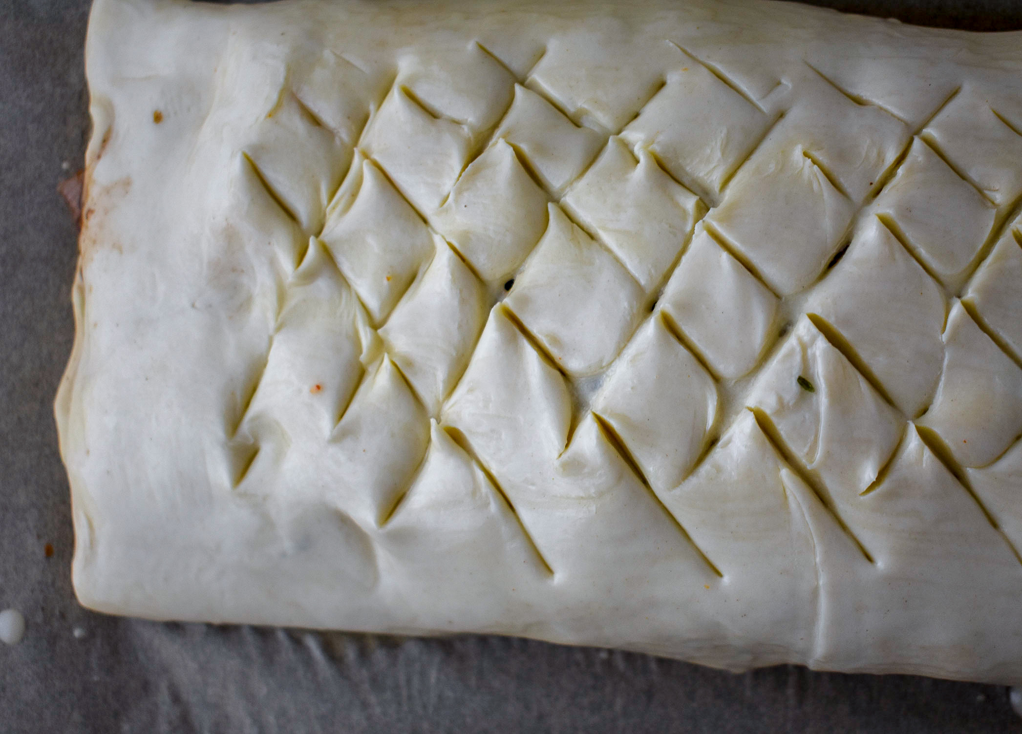7. After the egg wash, make a lattice design cut ... diagonal cuts in each direction across the top. You can do other designs as well ... be creative!