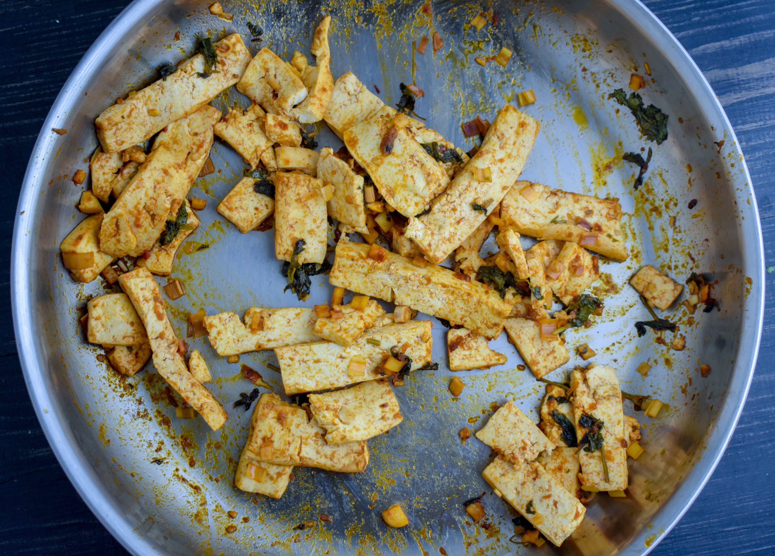 5. Next, add the tofu to your warm pan. It should sizzle and cook quickly. Cook until the marinade starts to cook off and tofu begins to crisp. Should take 5-6 minutes. While waiting, warm up your corn tortillas.