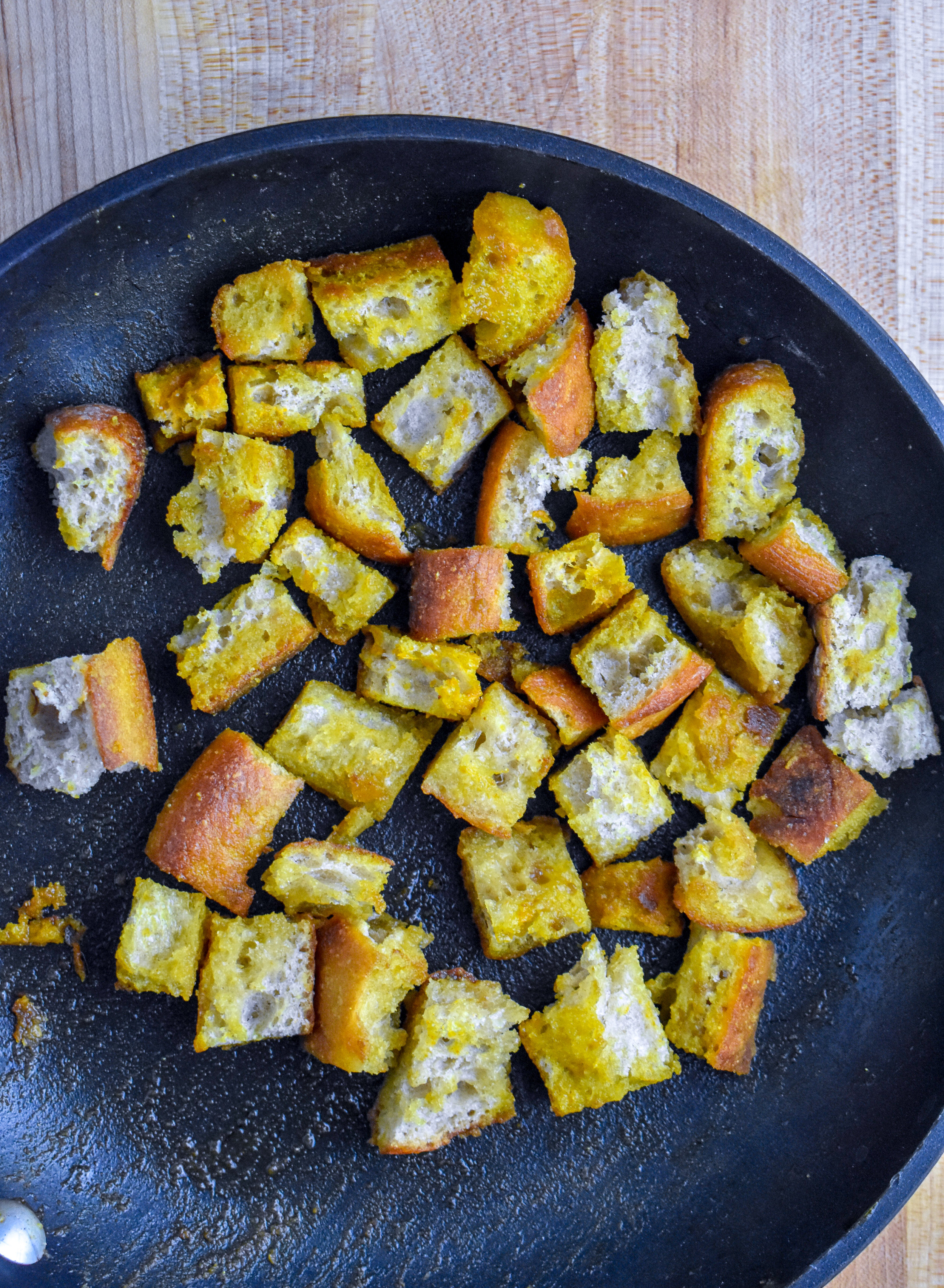 2. Once butter begins to pop, add the bread cubes, coat well and add spices. Cook 3-4 minutes over medium heat, flip cook another 3-4 minutes. Set aside.